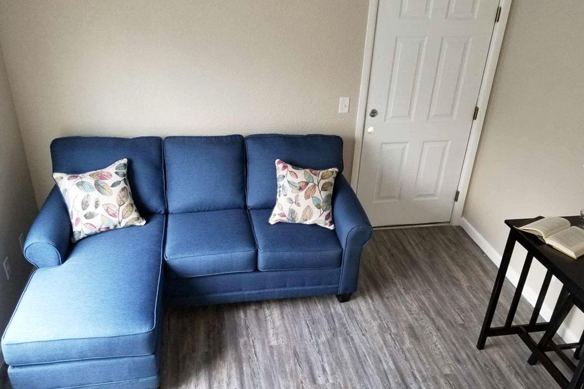 a living room with a couch and a chair