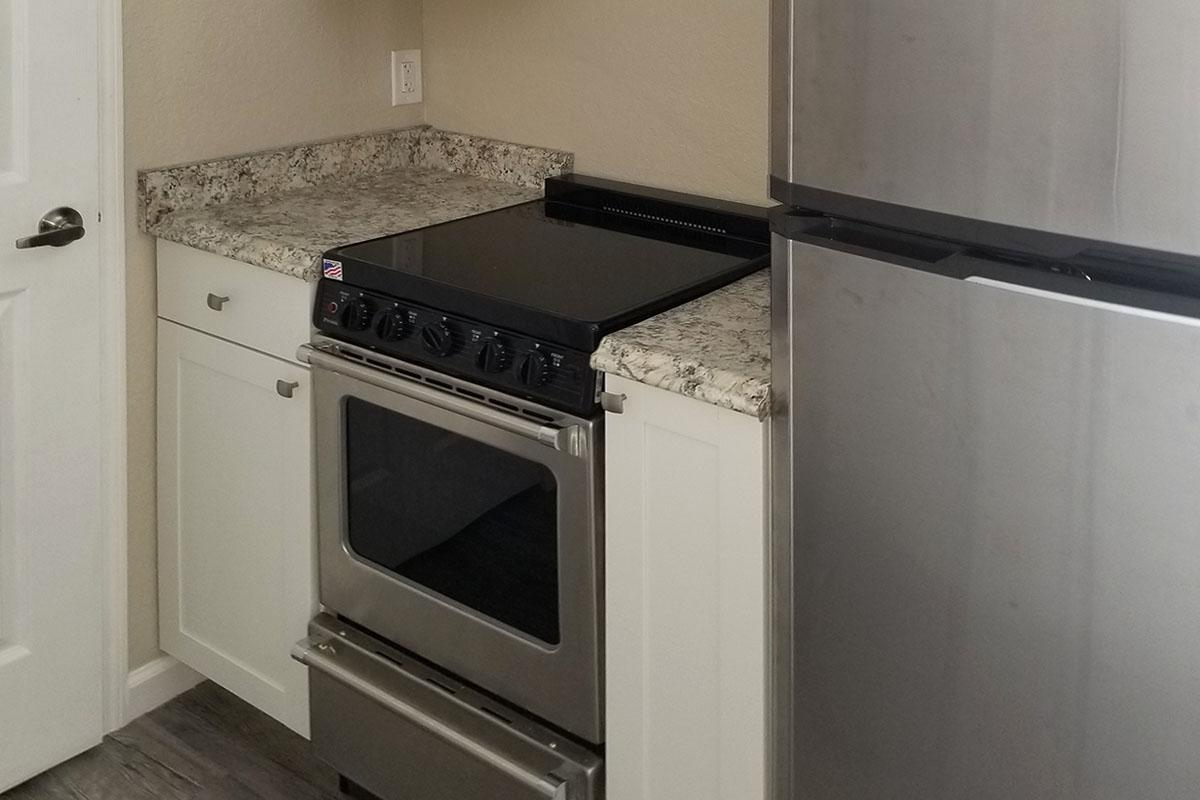 a white microwave oven sitting on top of a stove