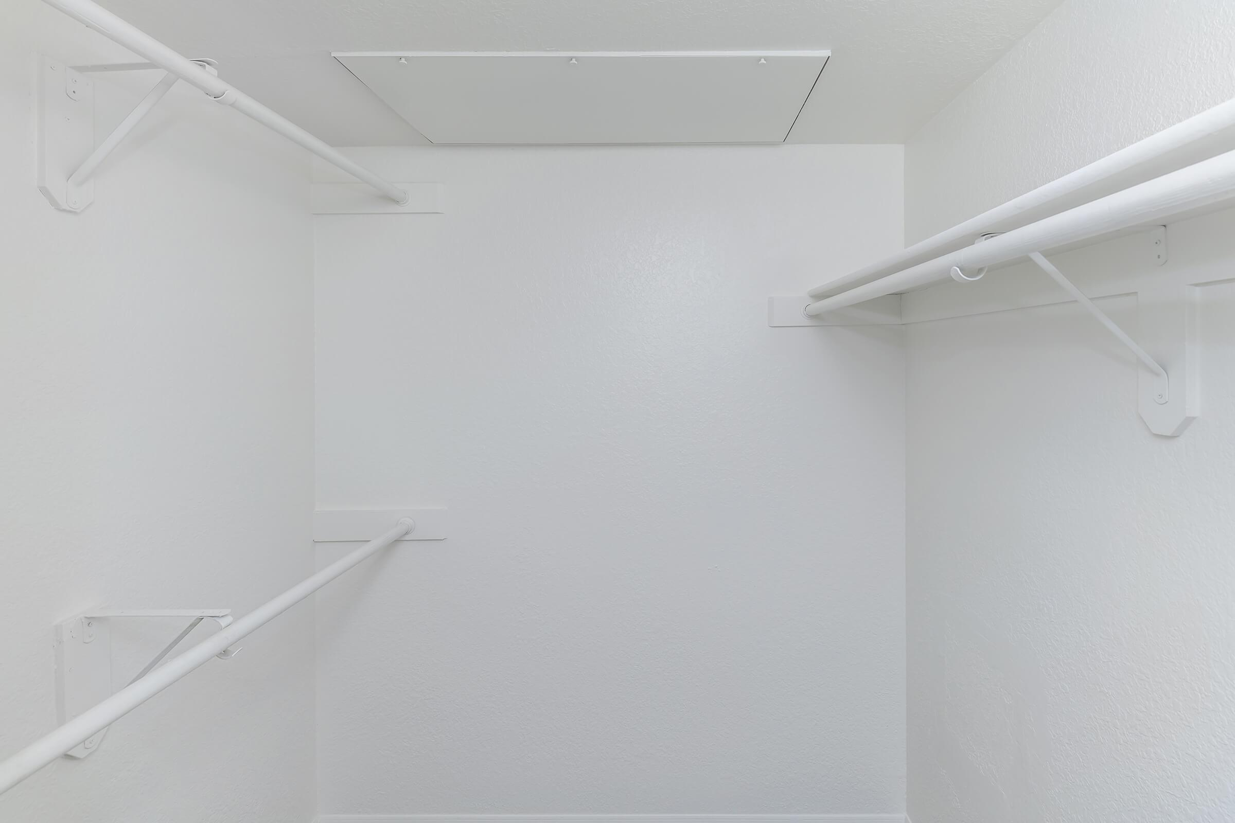 a white airplane hanging from the ceiling