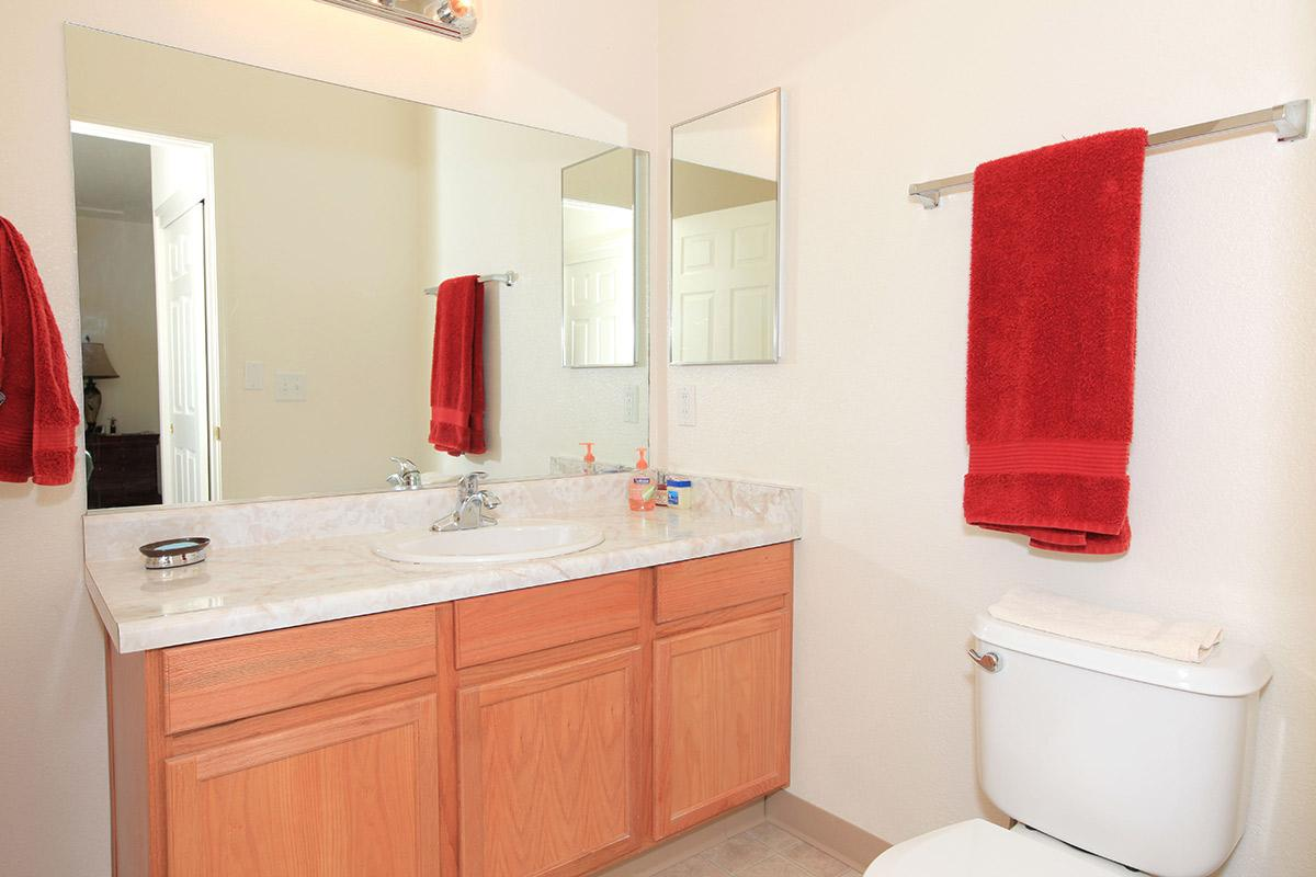a red and white sink in a kitchen