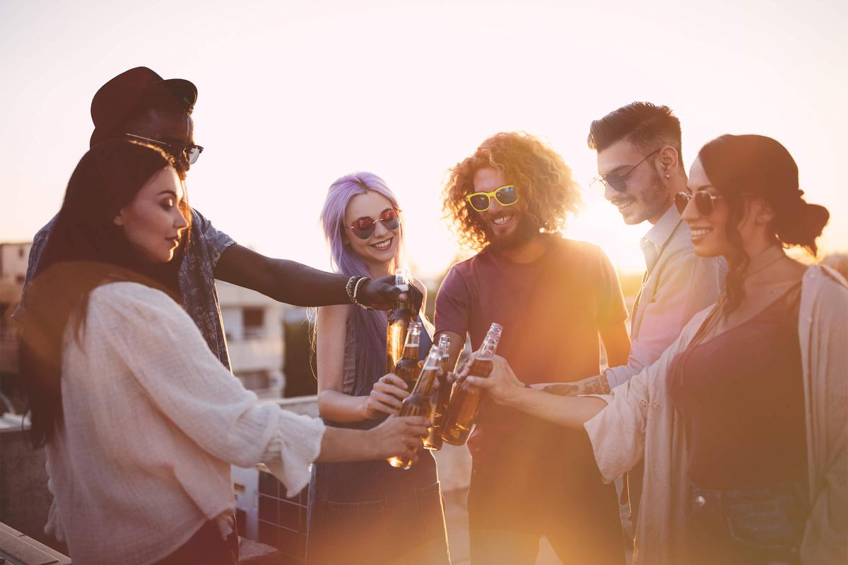 a group of people holding wine glasses