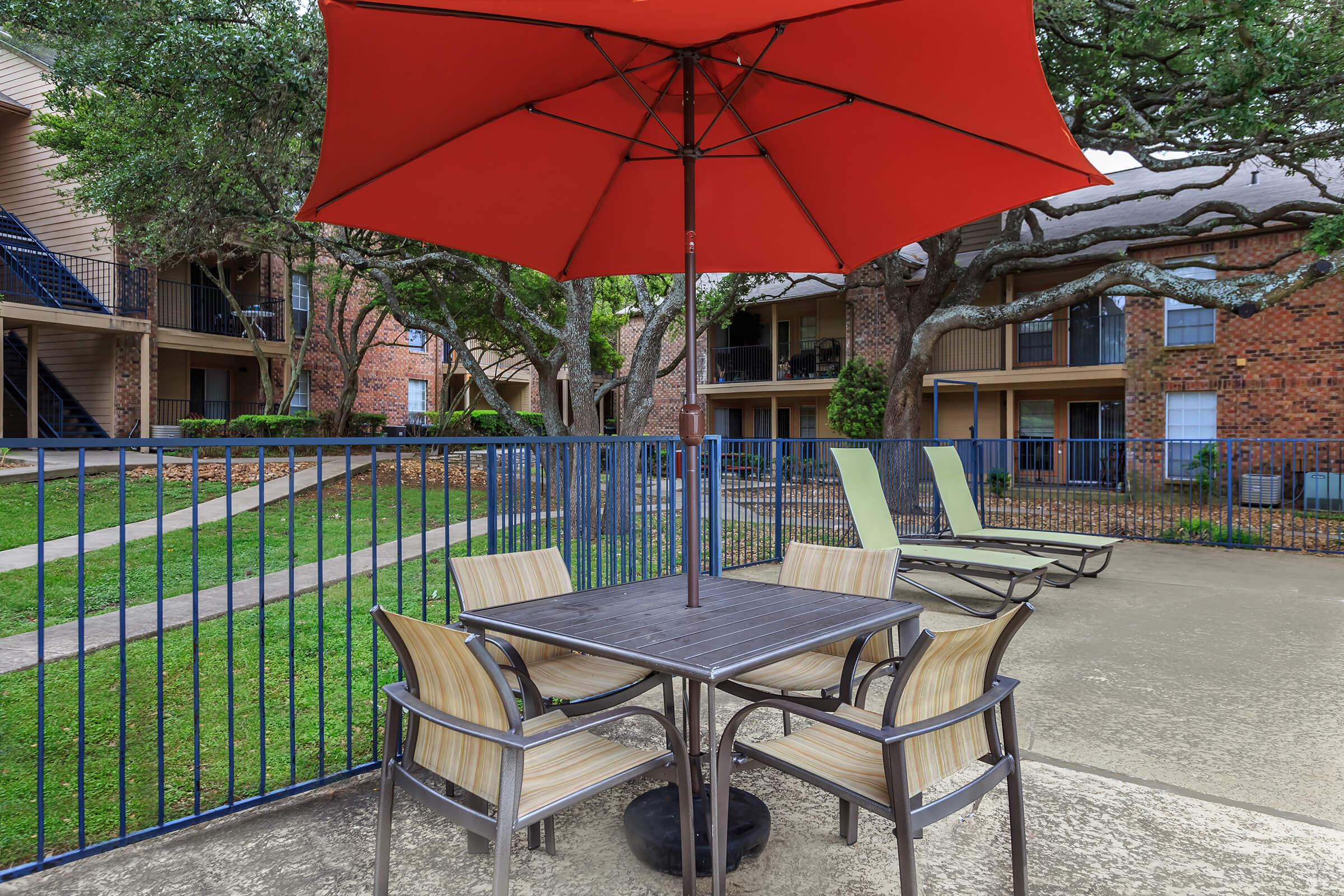 a lawn chair under an umbrella