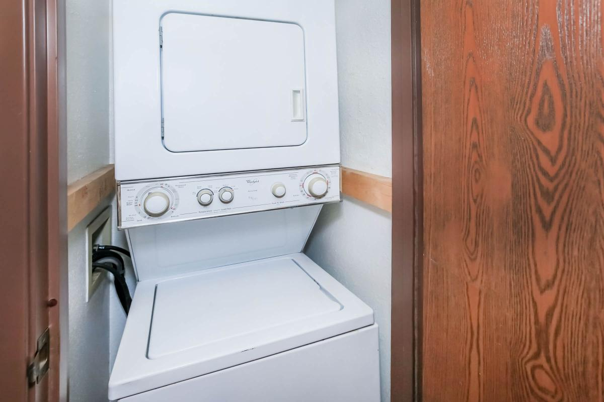 a white microwave oven sitting on top of a wooden door