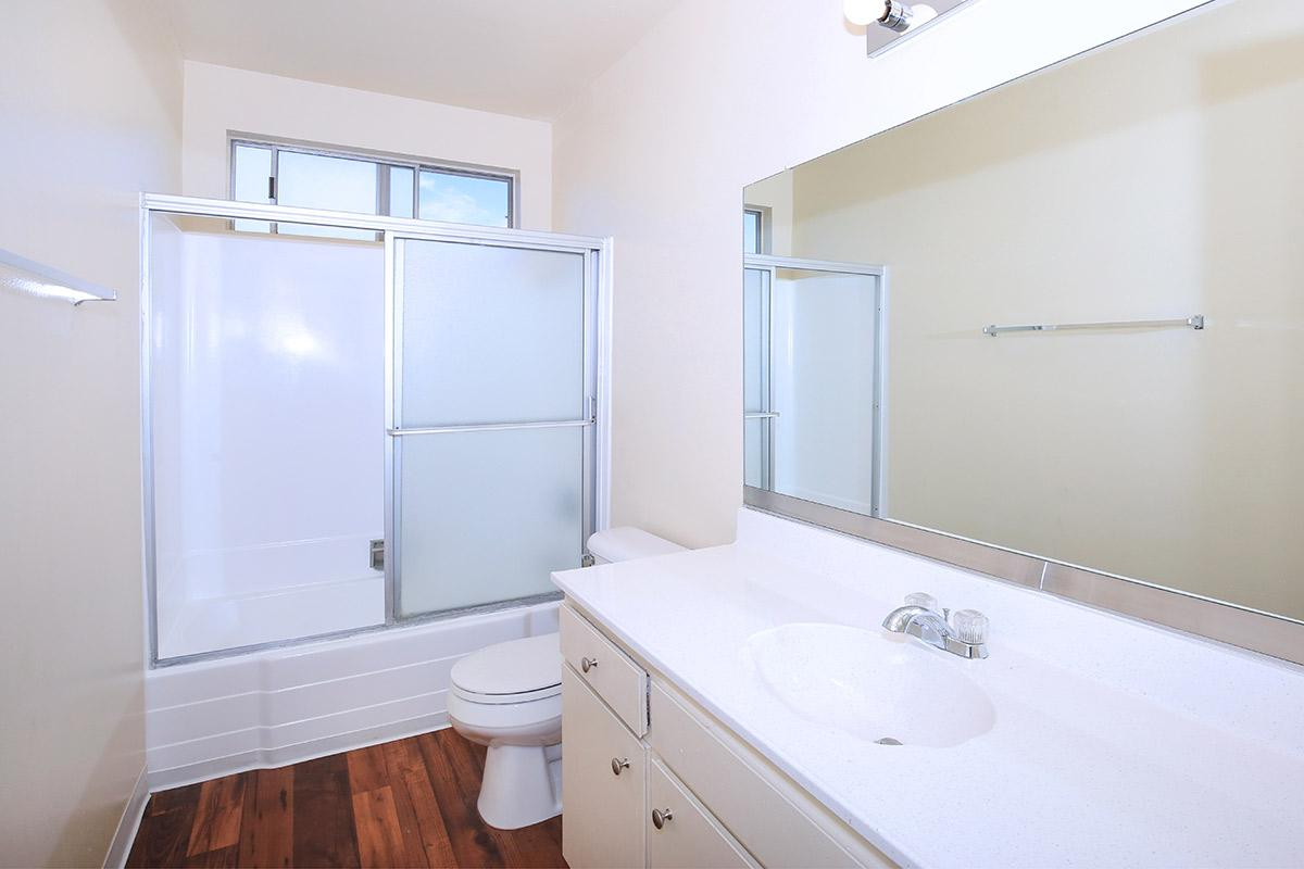 a large white tub next to a glass shower door