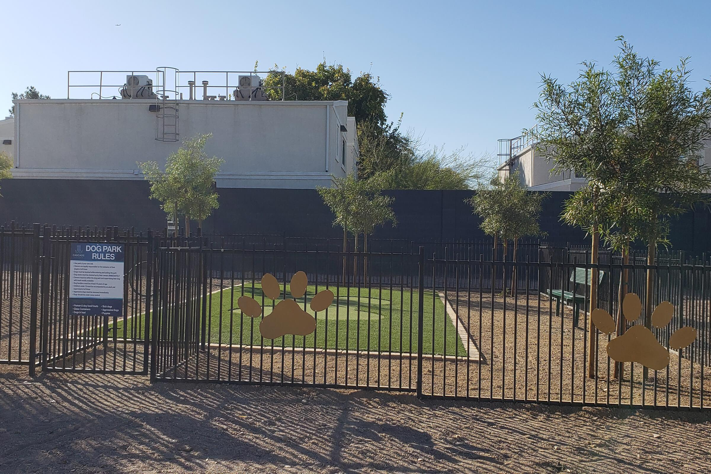 a gate in front of a fence