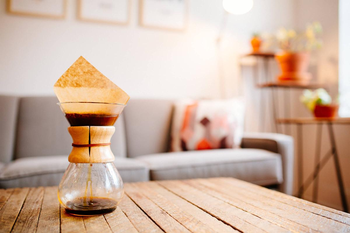 a vase sitting on top of a wooden table