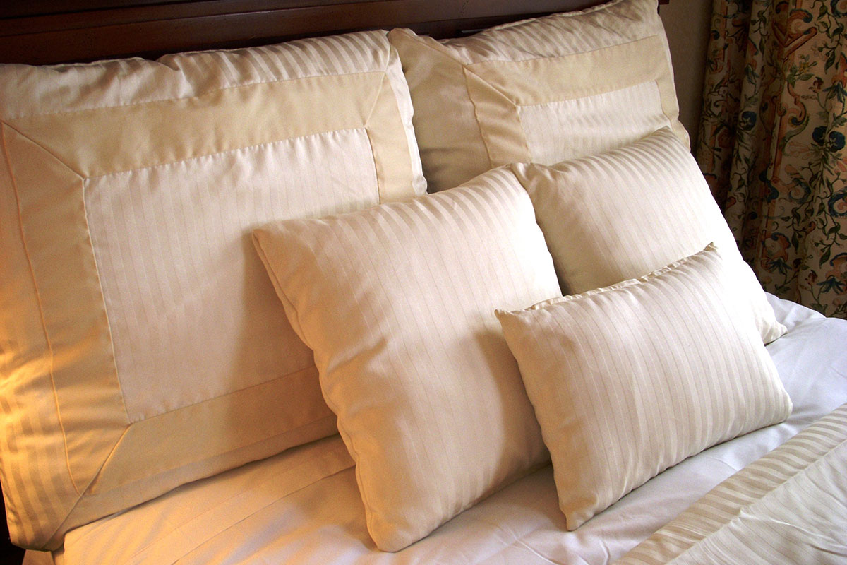 a white pillow on a bed