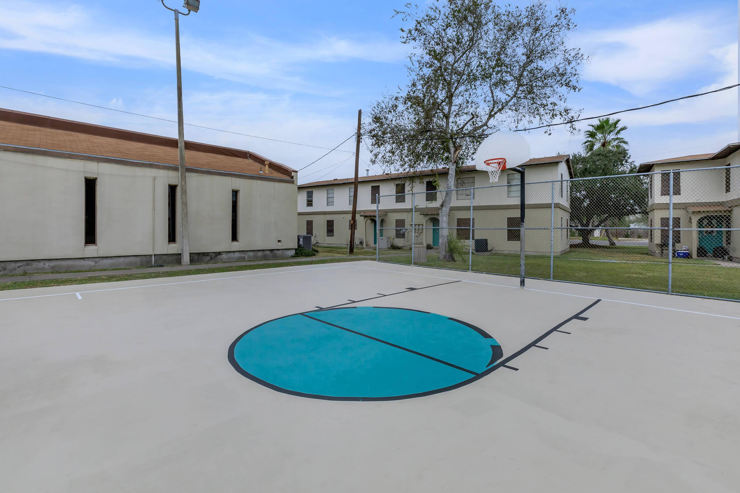 a house that has a racket in front of a building