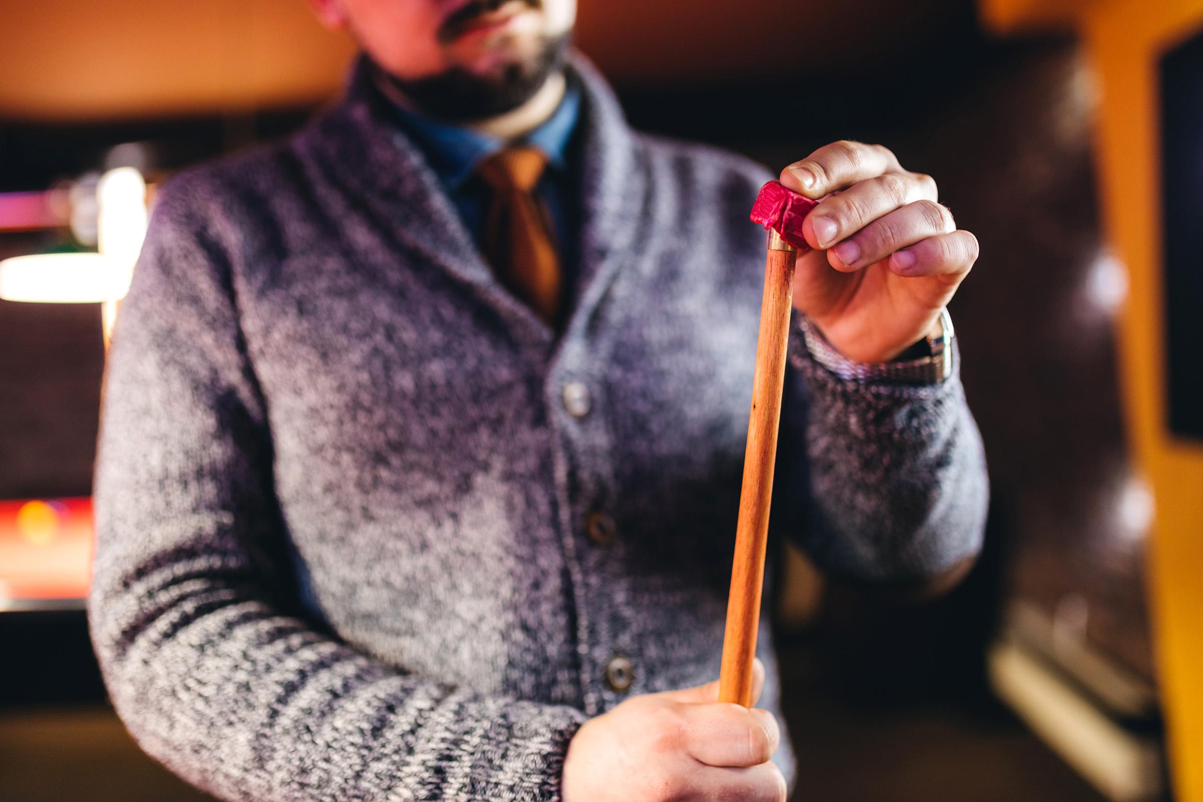 a hand holding a baseball bat