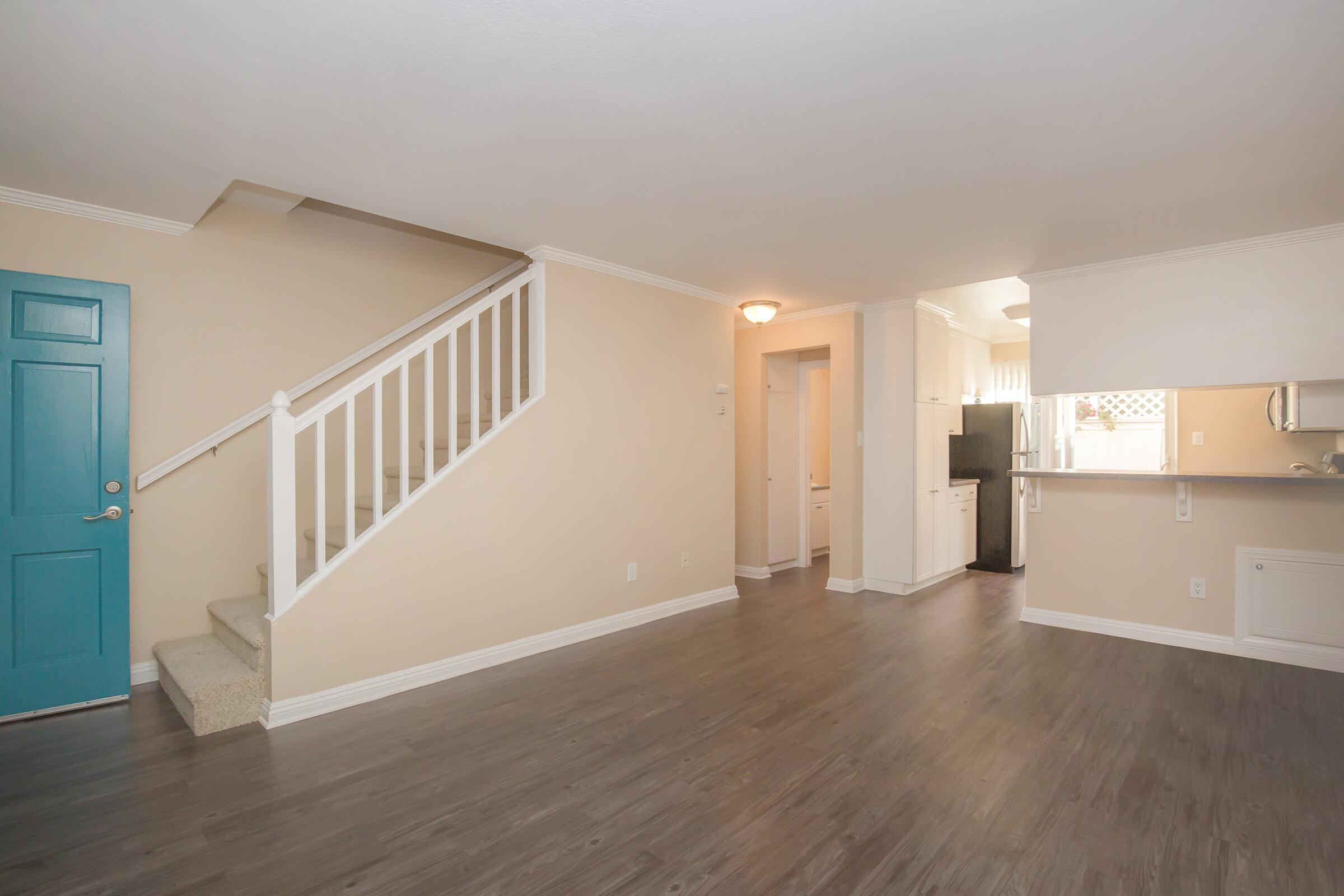Vacant living room with stairs
