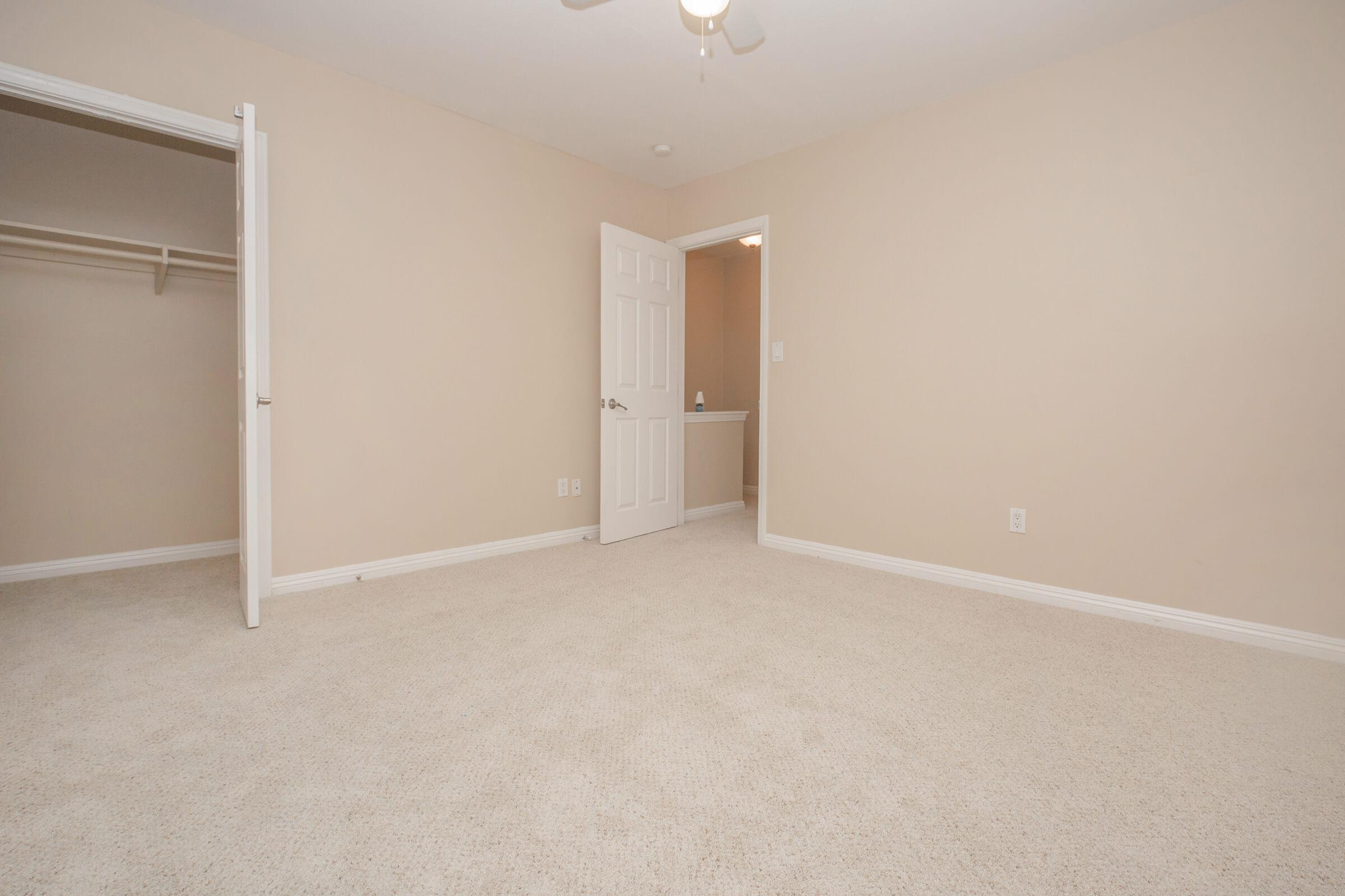 Vacant bedroom with open closet