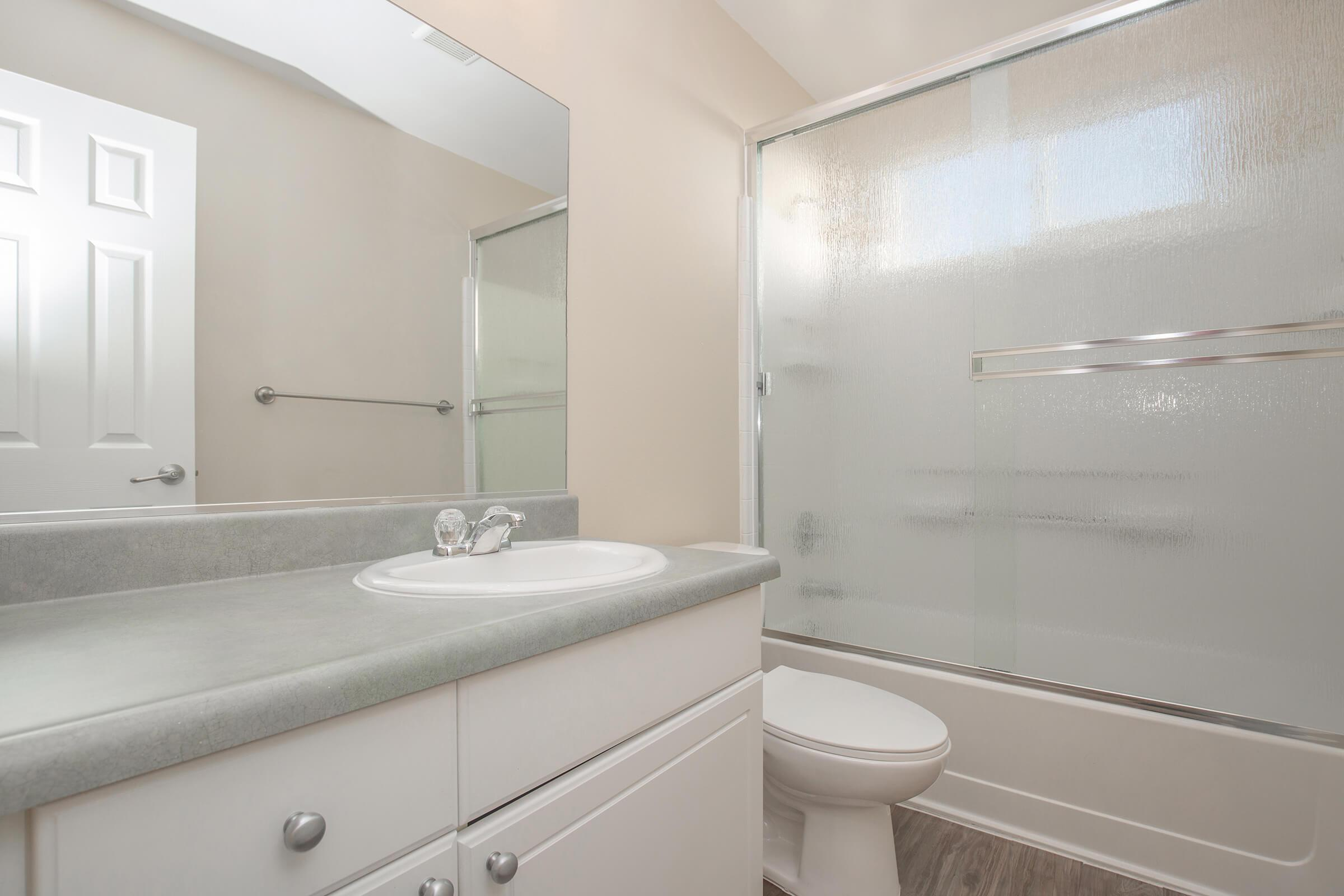 Bathroom with glass sliding doors