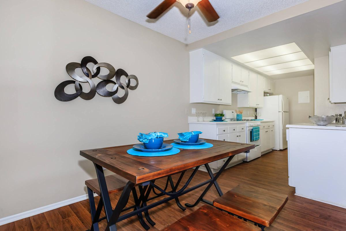 a kitchen with a blue chair