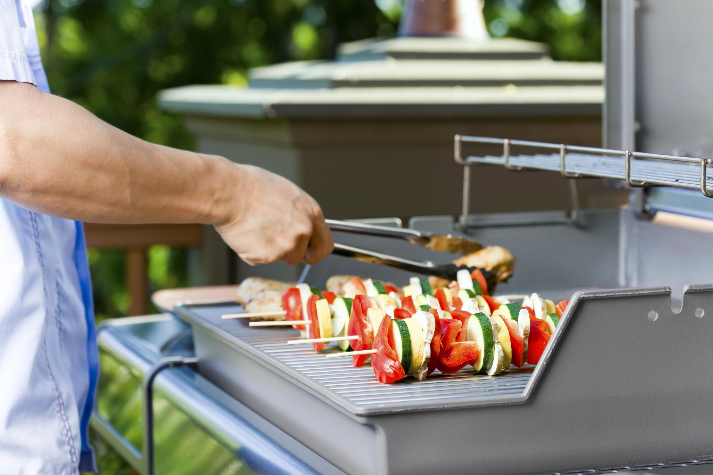 a man cutting food on a tray