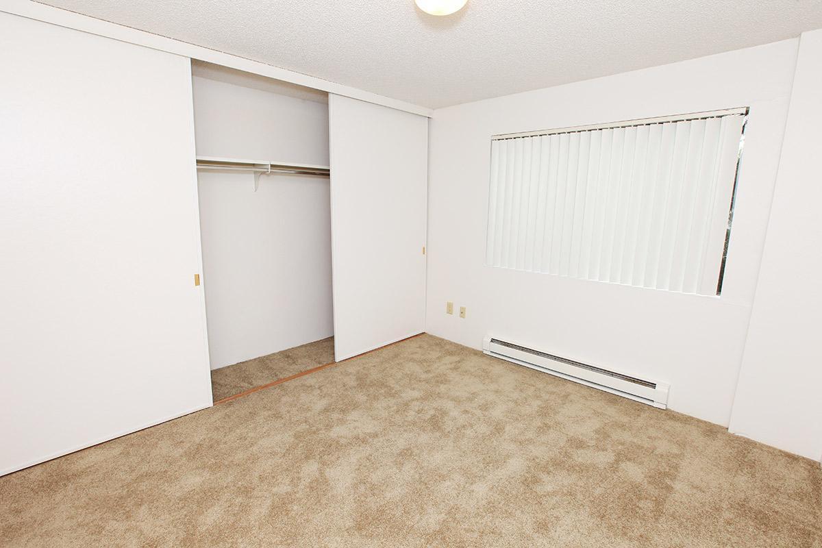 a white refrigerator freezer sitting inside of a room