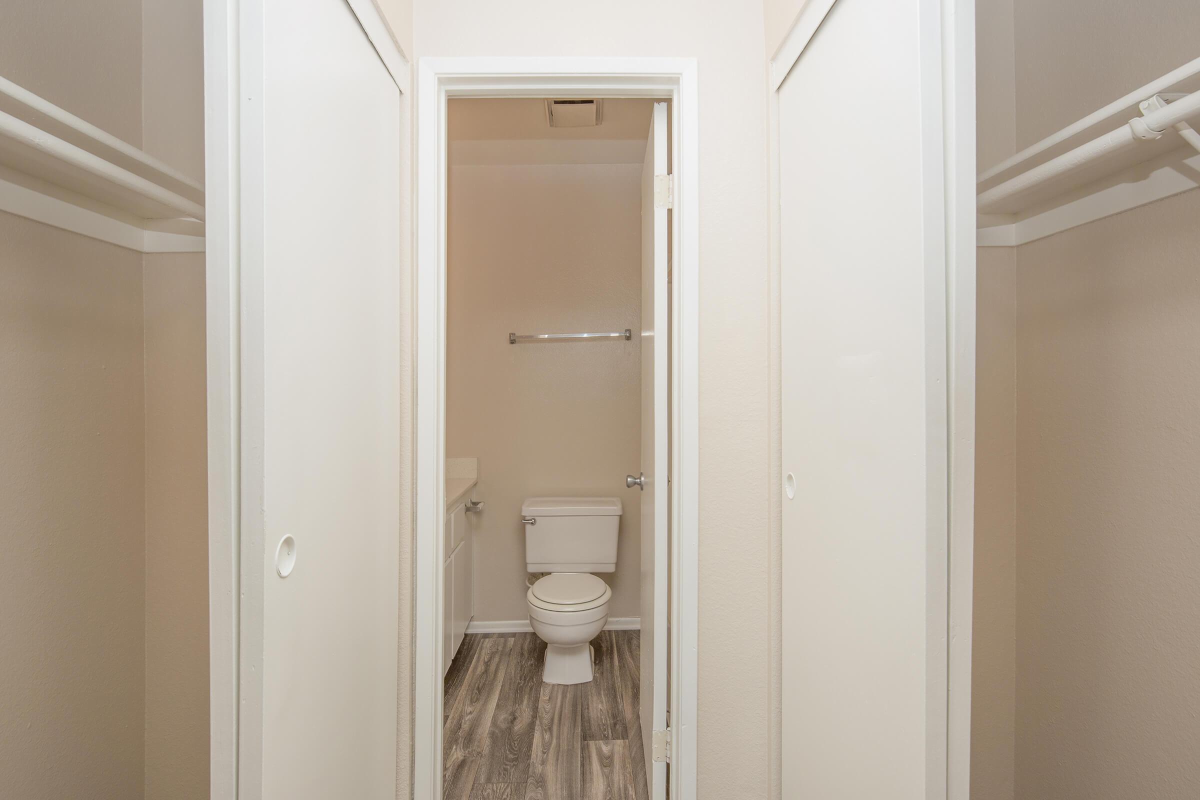 a white sink sitting next to a door