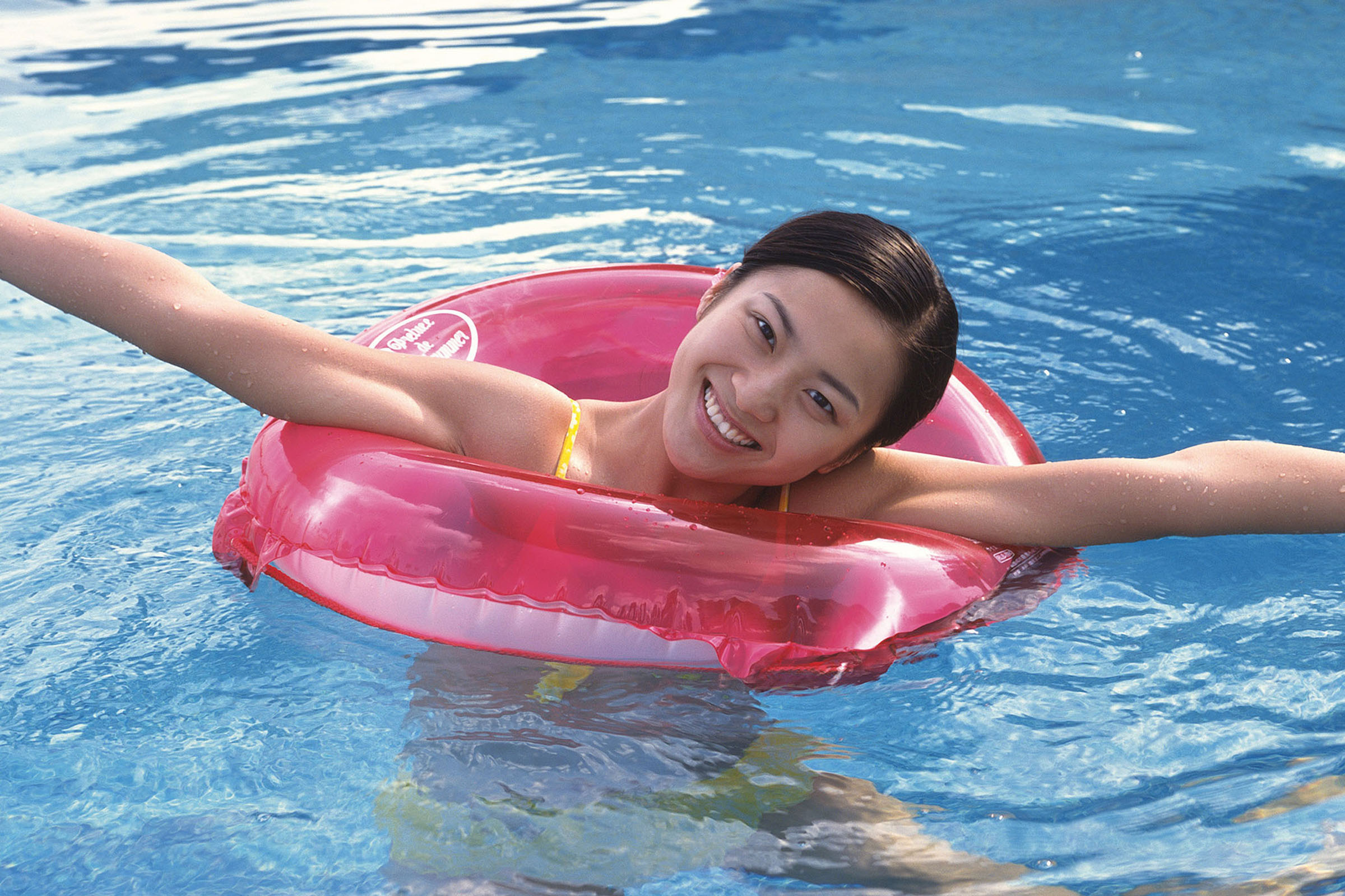 a girl in a pool of water