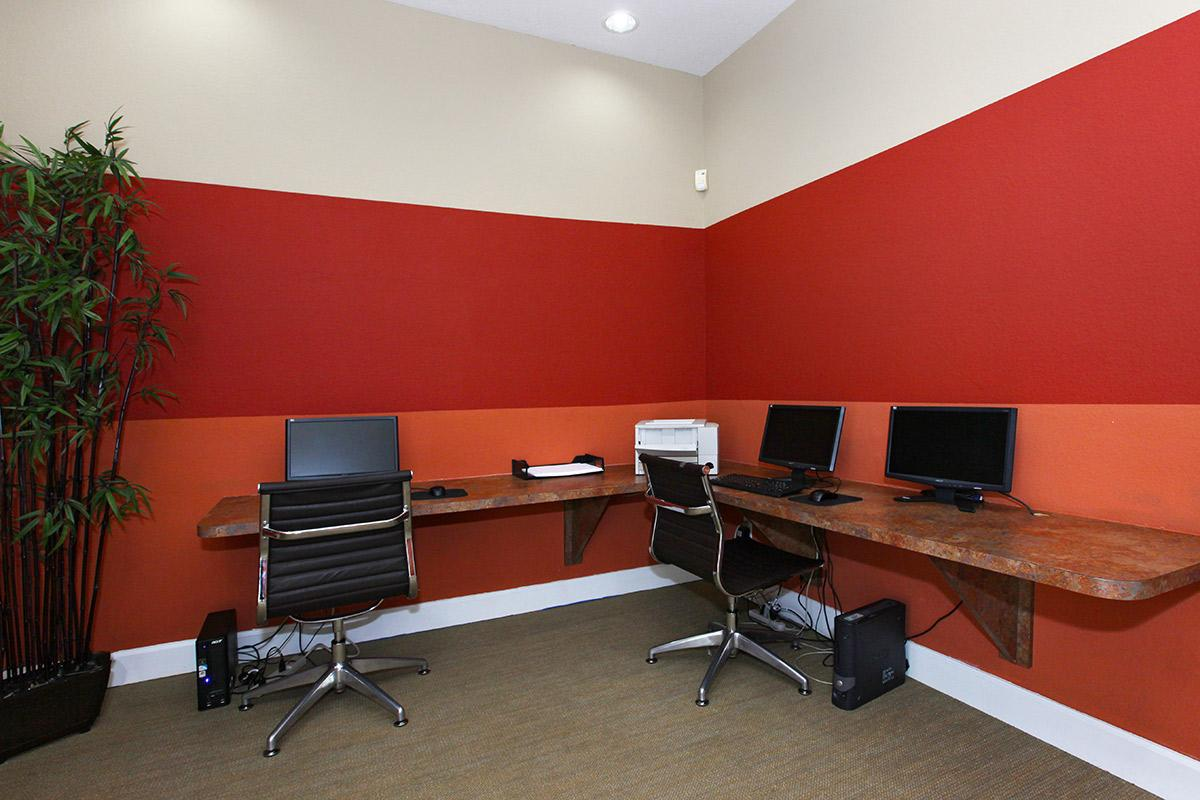 a red office chair in a room