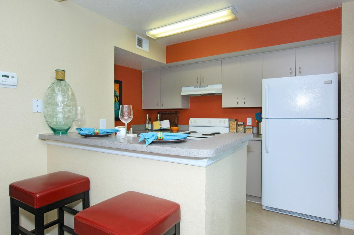 a red refrigerator in a kitchen