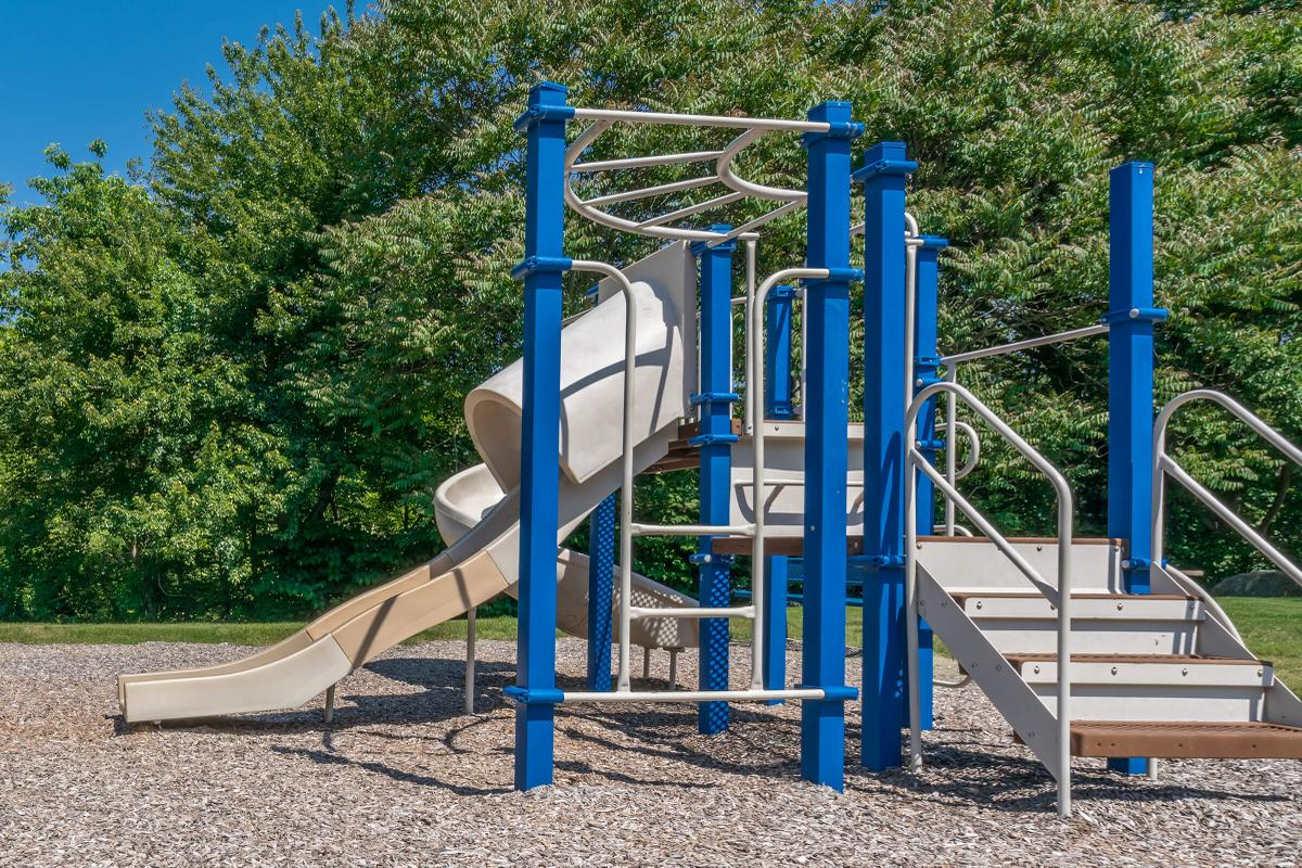 a playground with a blue chair