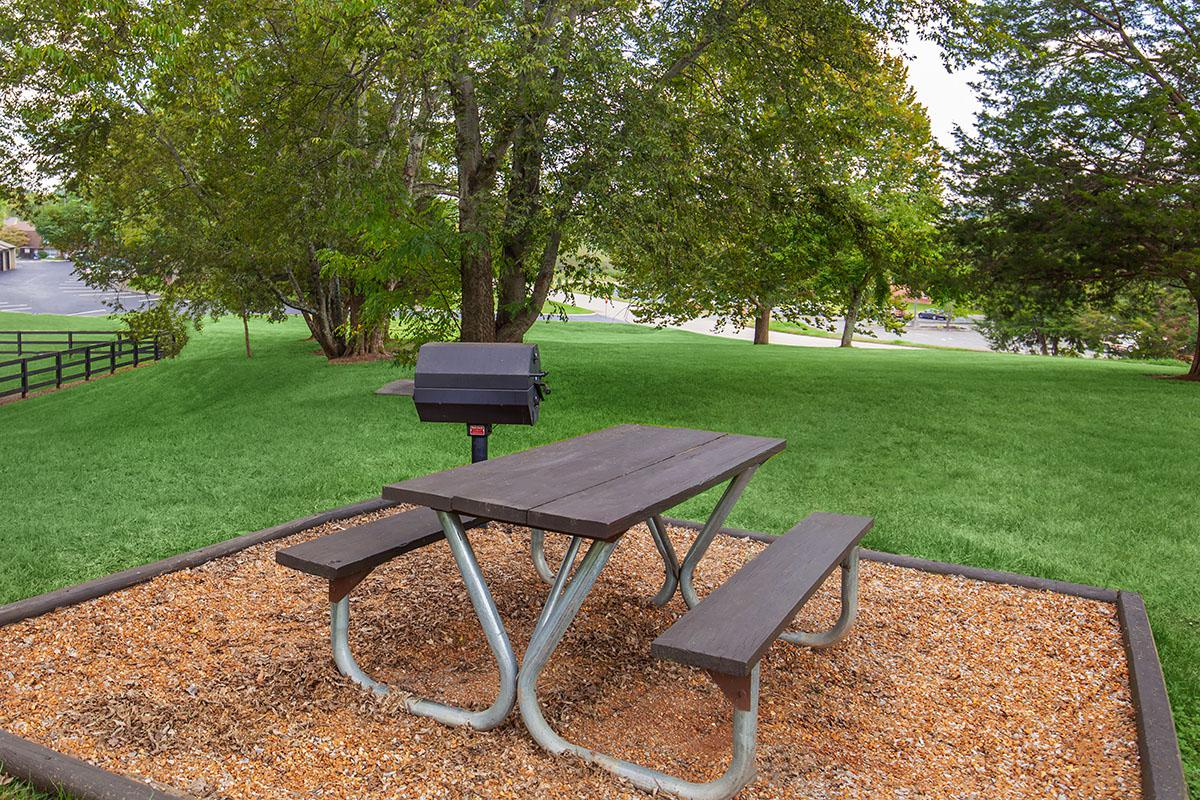 a couple of lawn chairs sitting on top of a picnic table