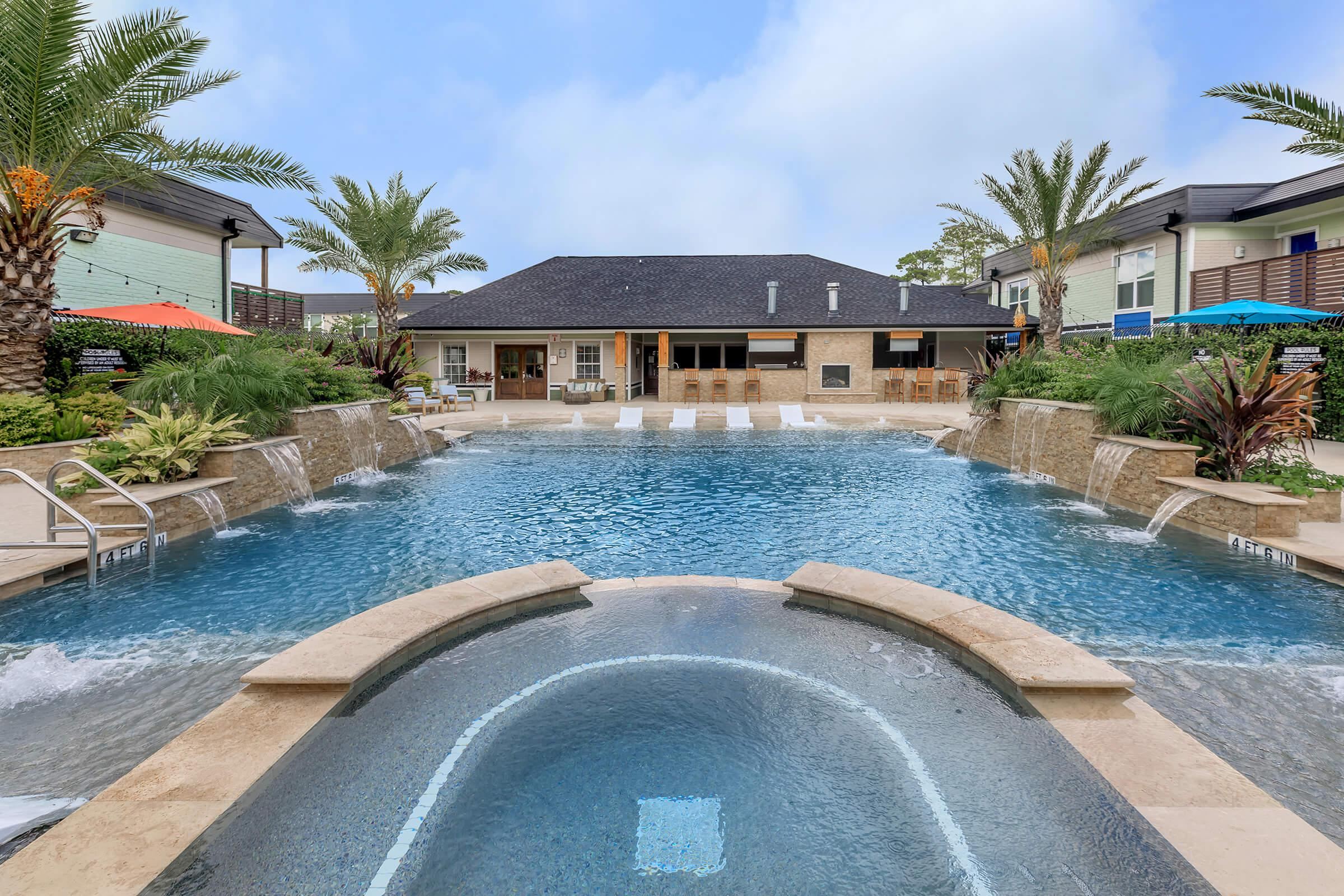 a pool of water in front of a house