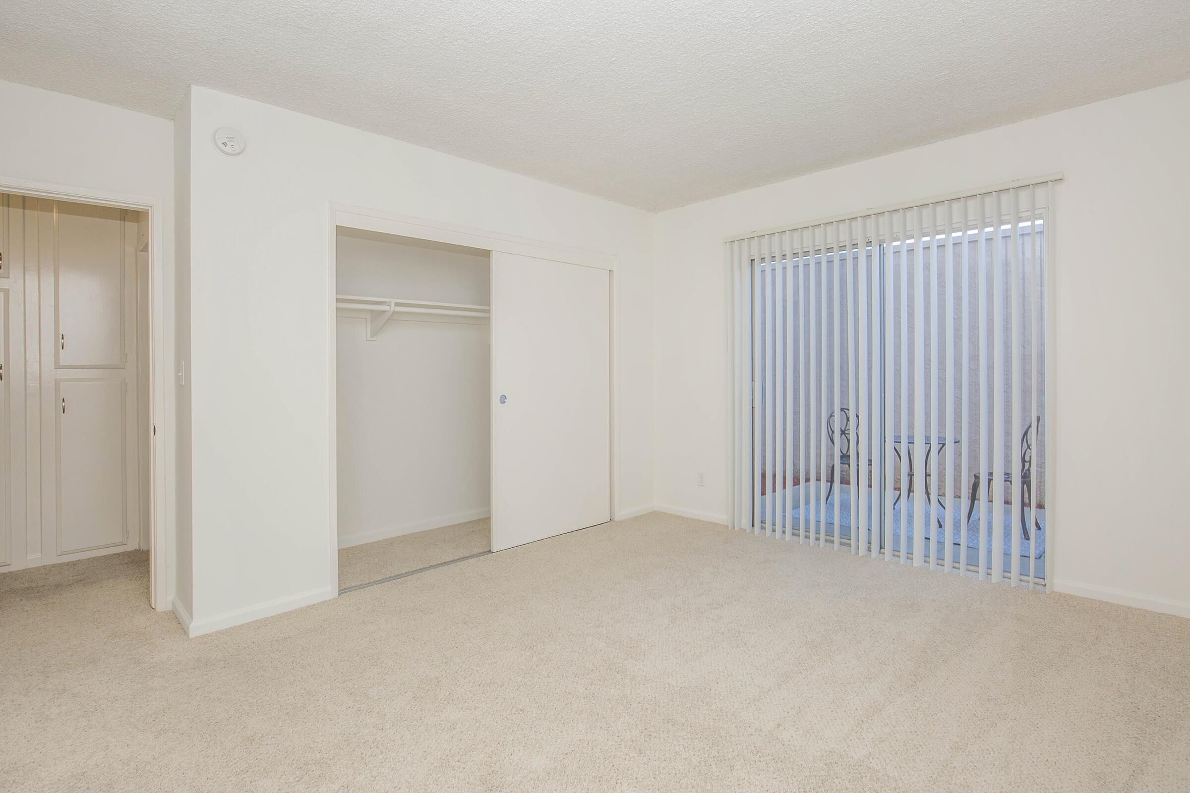 Bedroom with sliding glass doors to patio