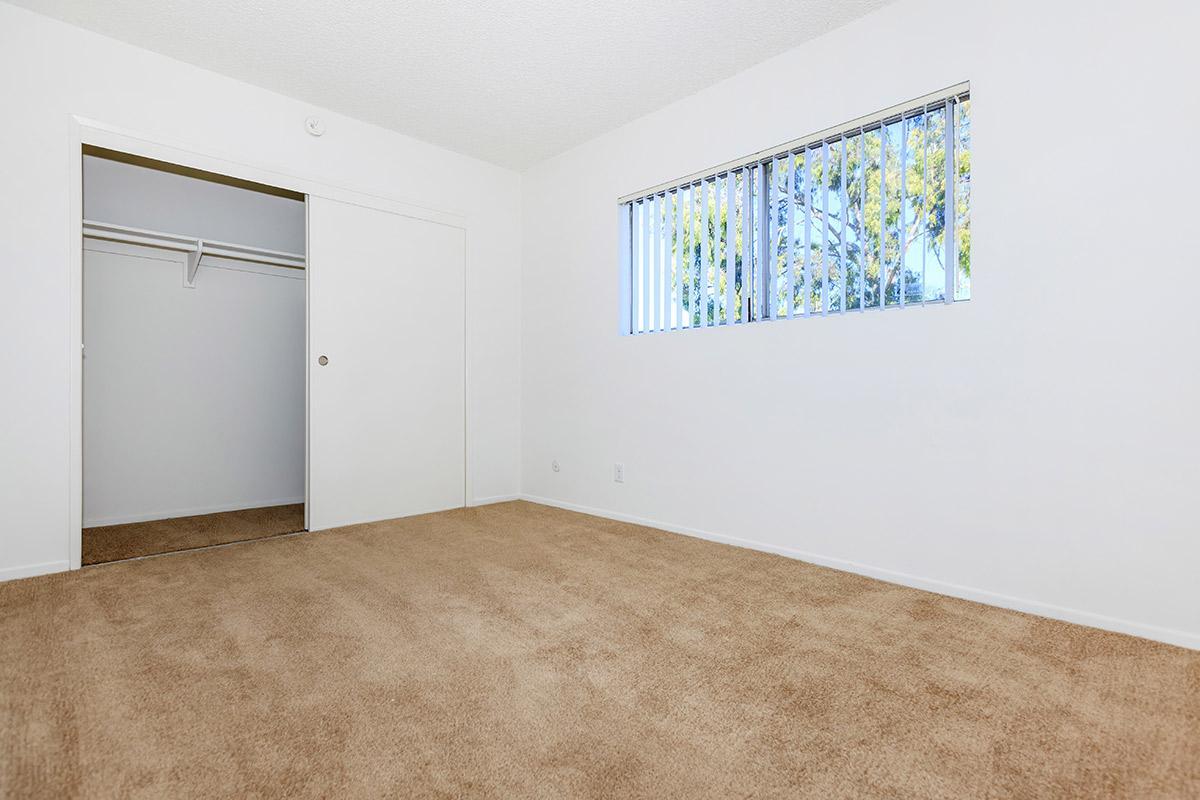 Bedroom with open sliding closet door