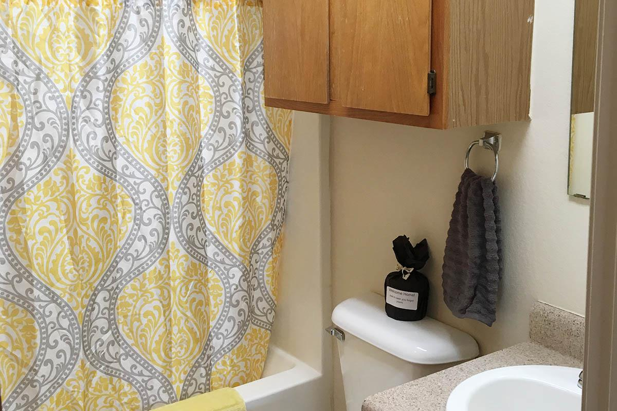 a yellow and white shower curtain