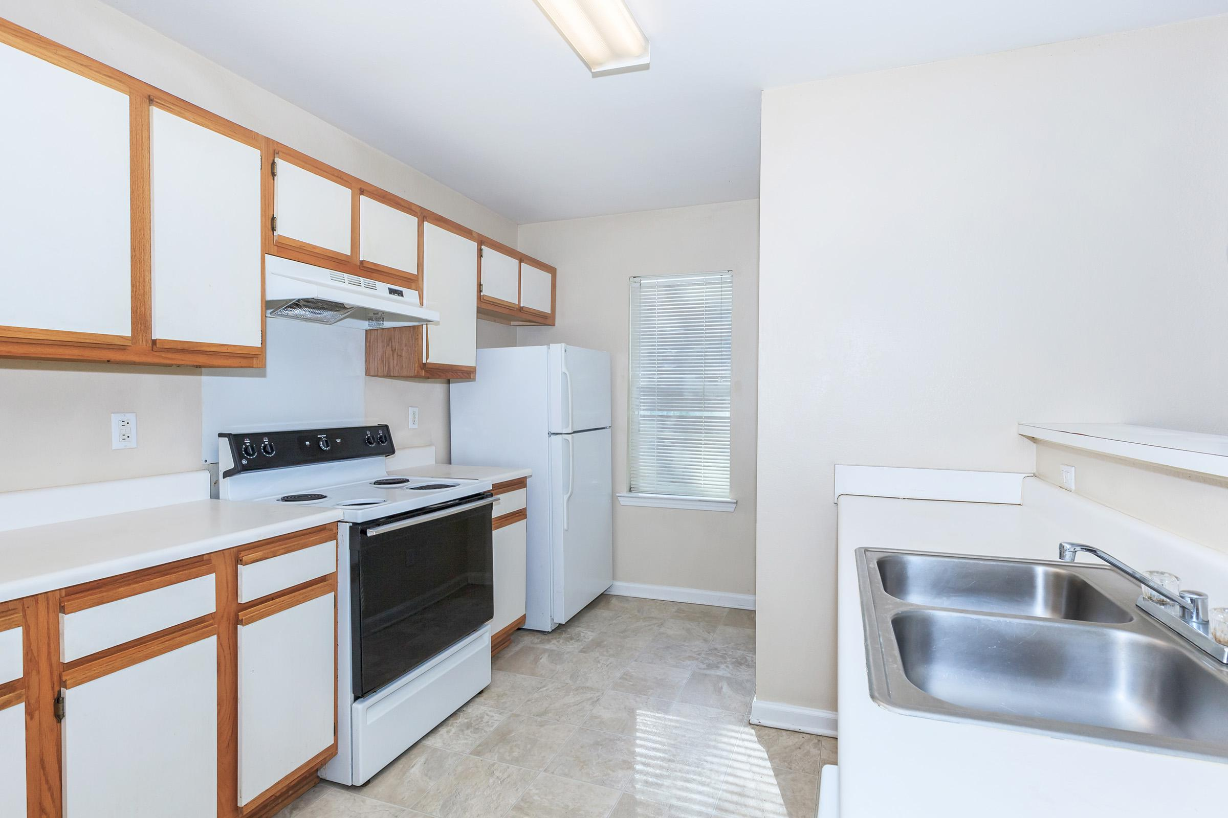 a kitchen with a sink and a window
