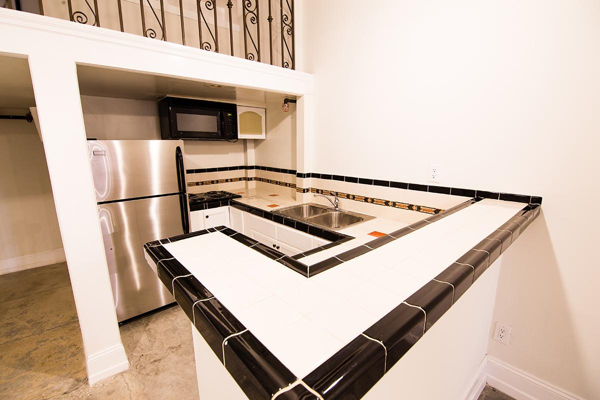 Gourmet kitchen with stainless steel refrigerator at Ancelle