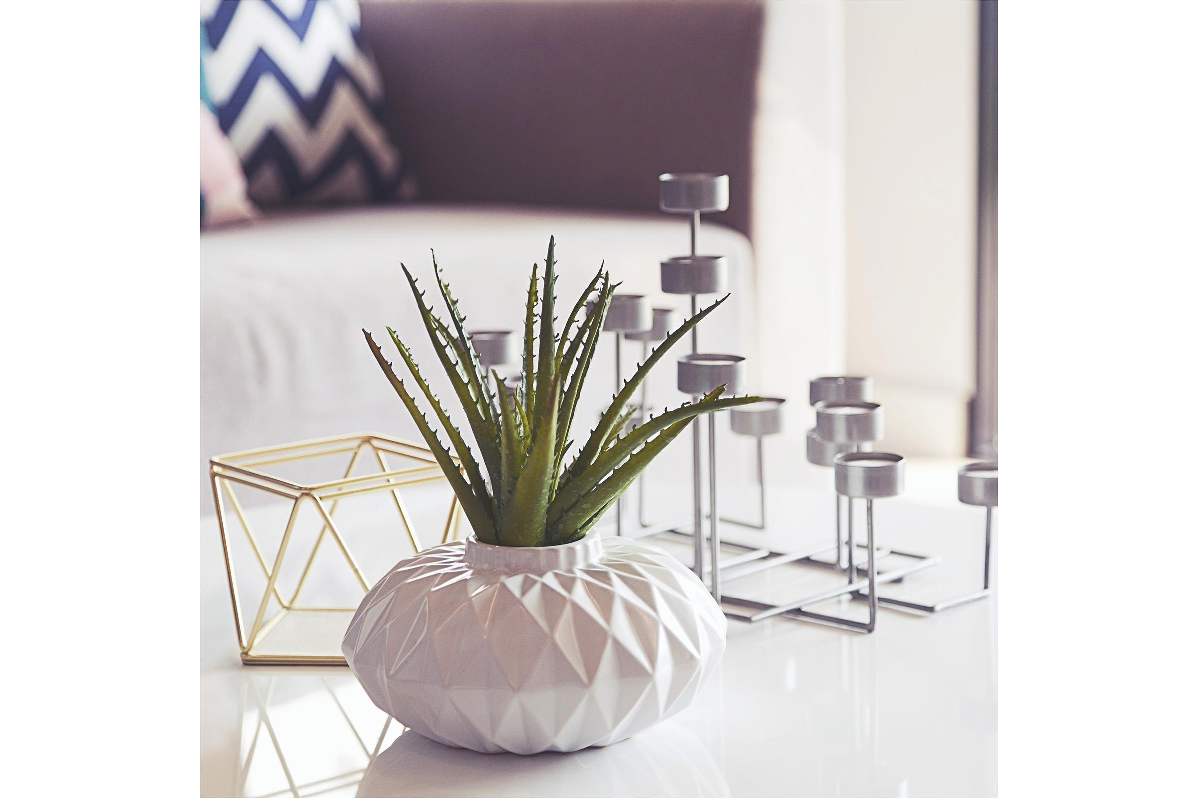 a glass vase on a table