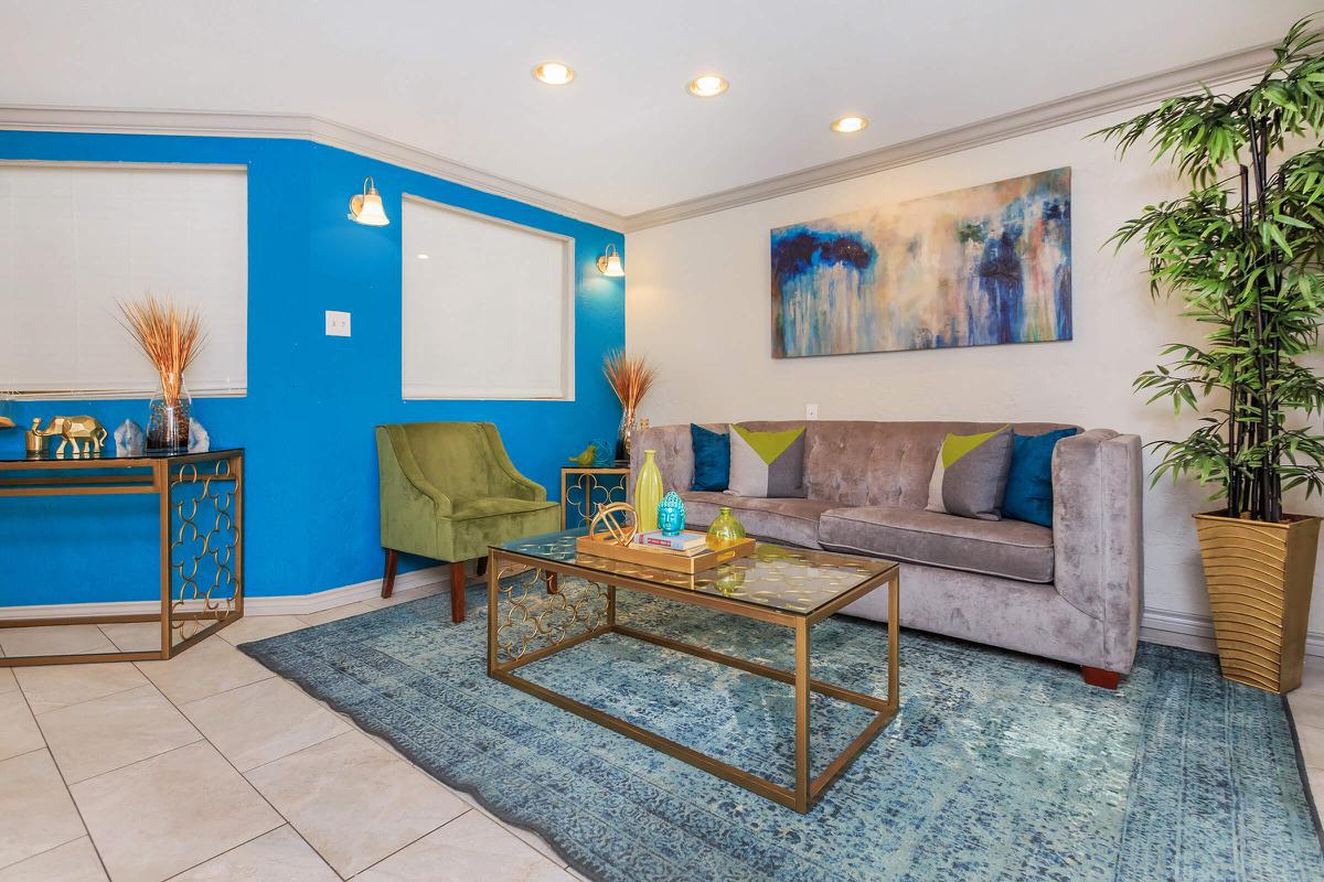 a living room with blue walls