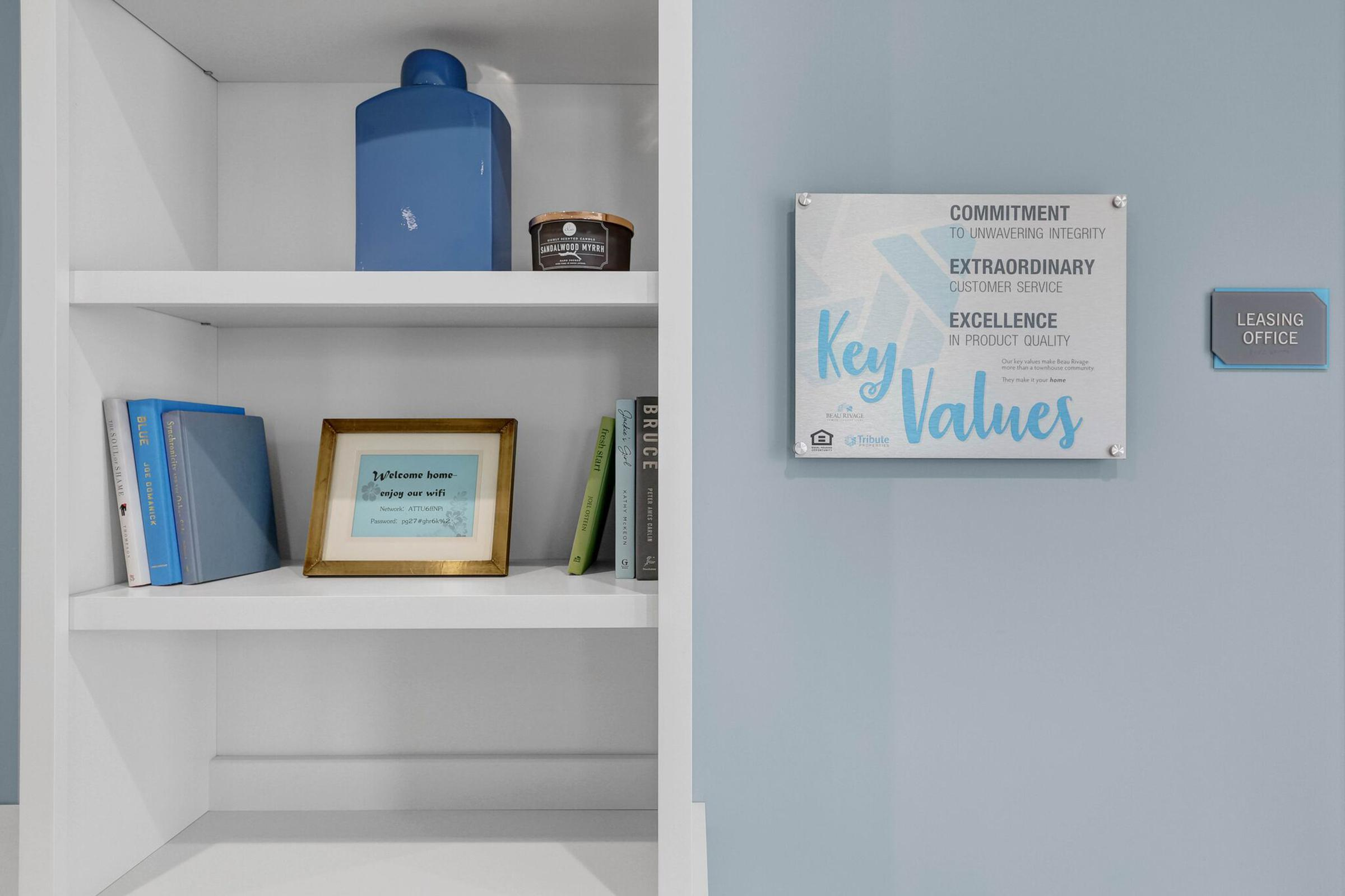 a blue and white sign on a shelf