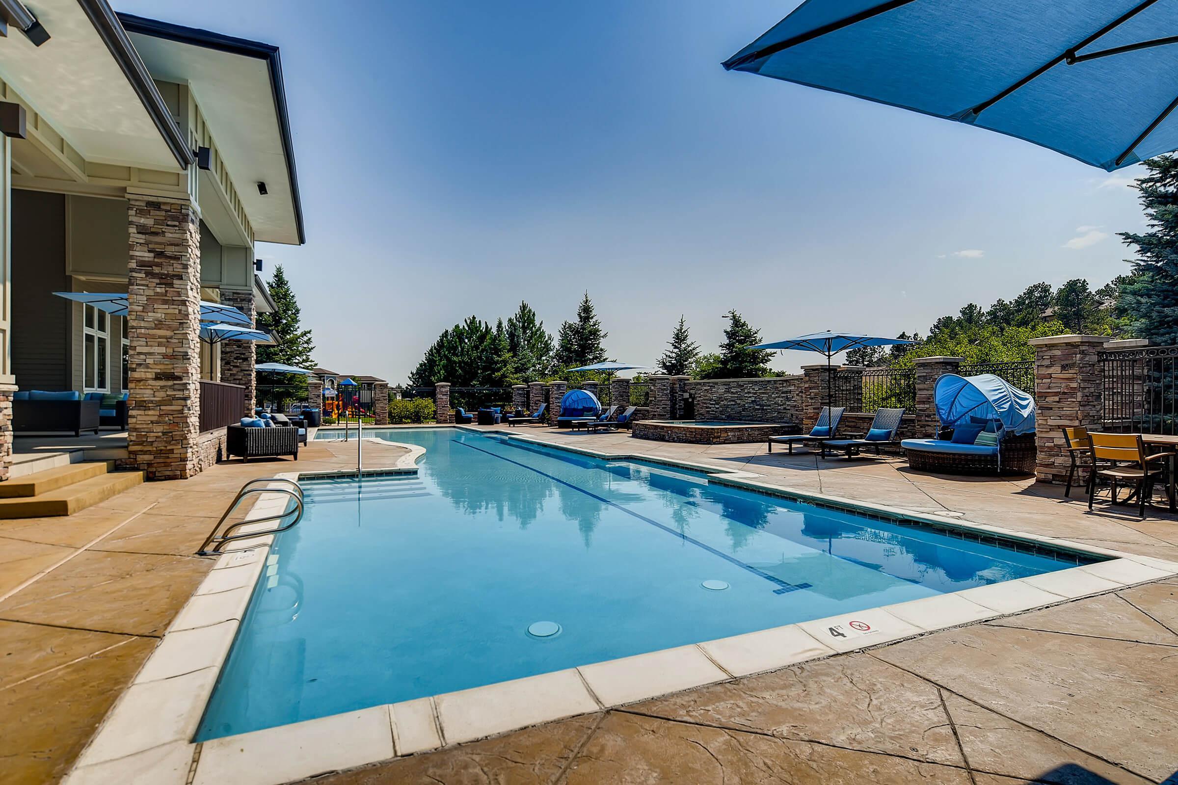a pool with a blue umbrella
