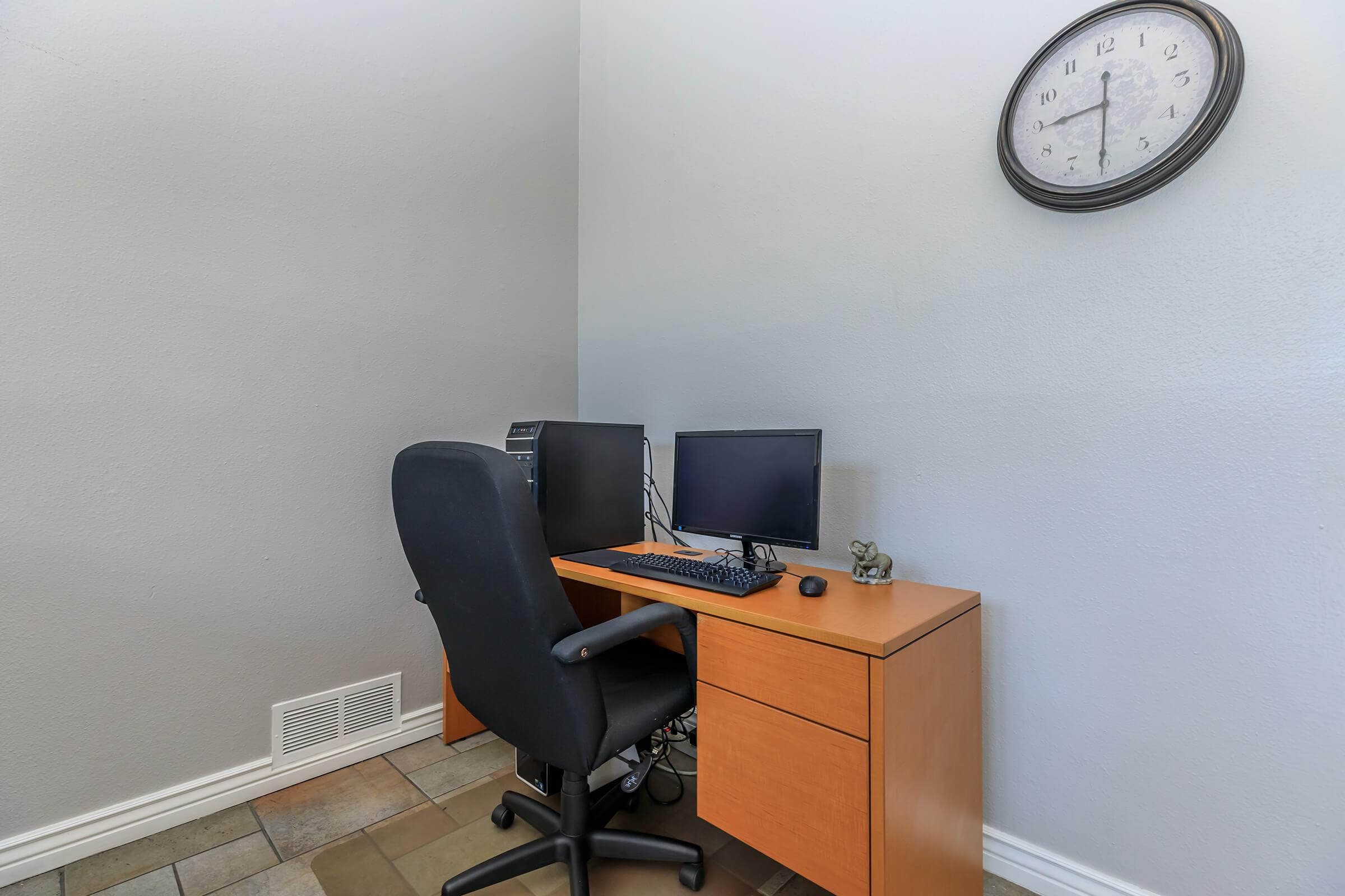 a chair sitting in front of a computer