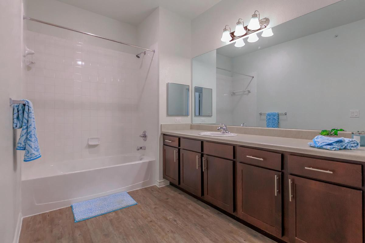 a kitchen with a sink and a shower