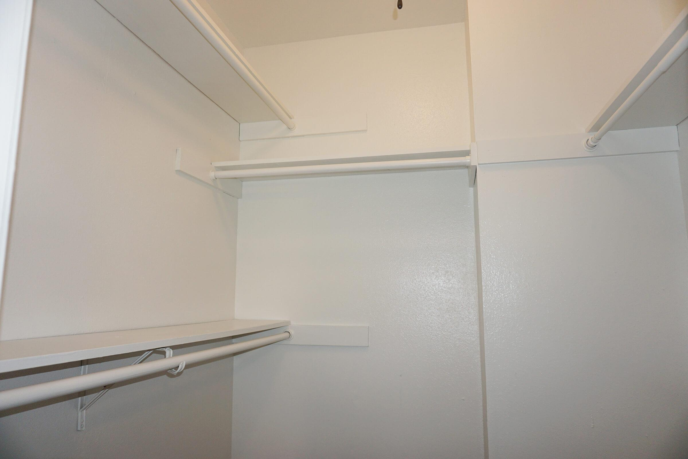 a white refrigerator freezer sitting inside of a building