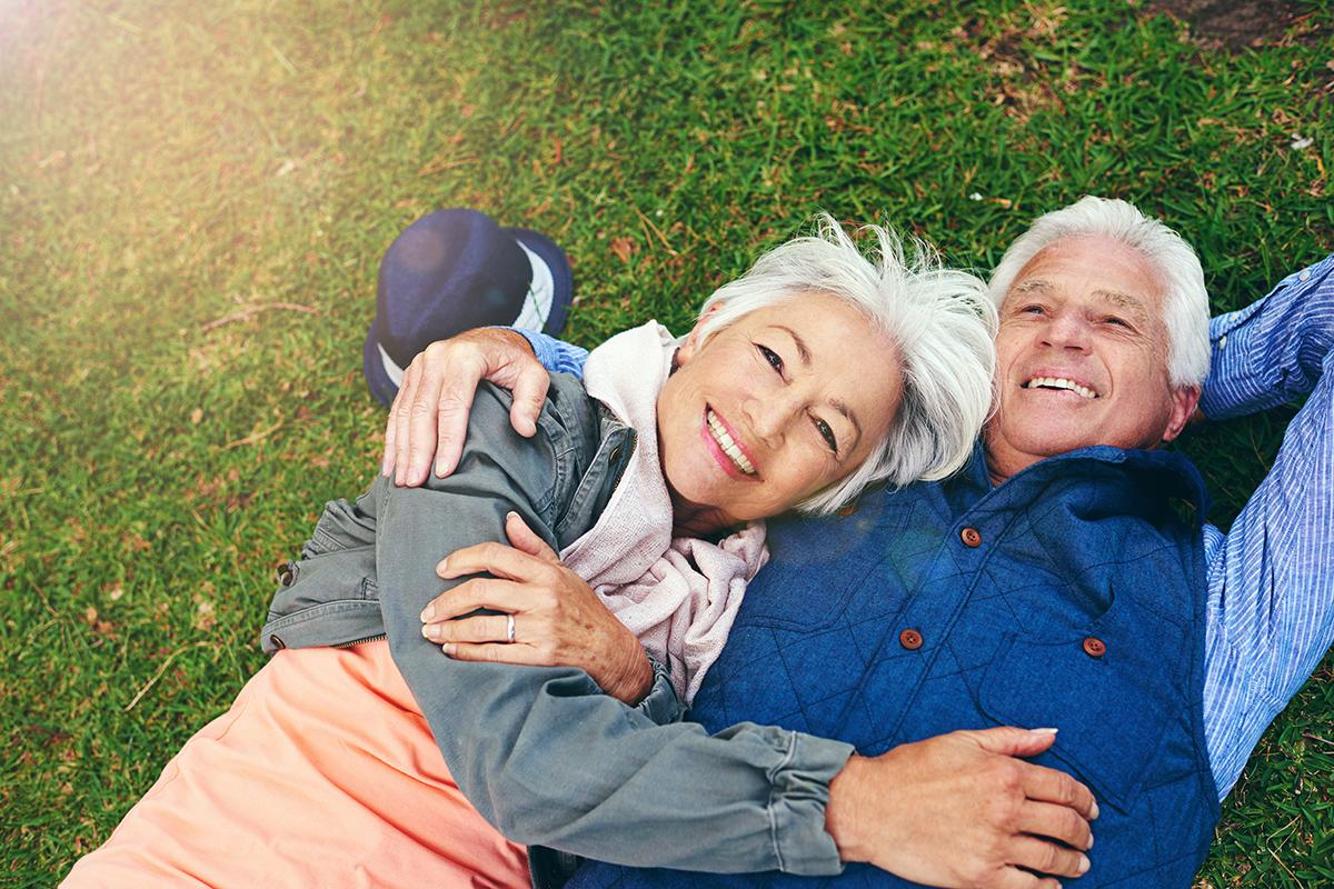 senior couple laying in grass.jpg