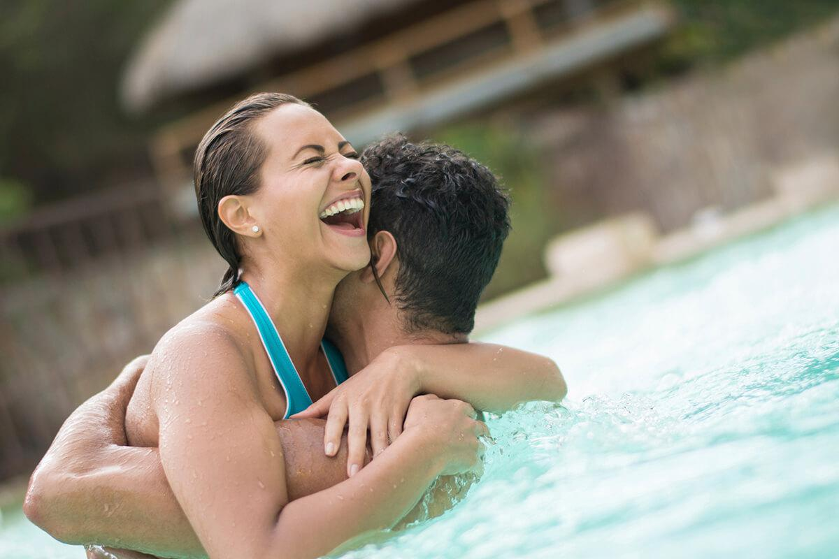 Lifestyle Photo of couple in pool