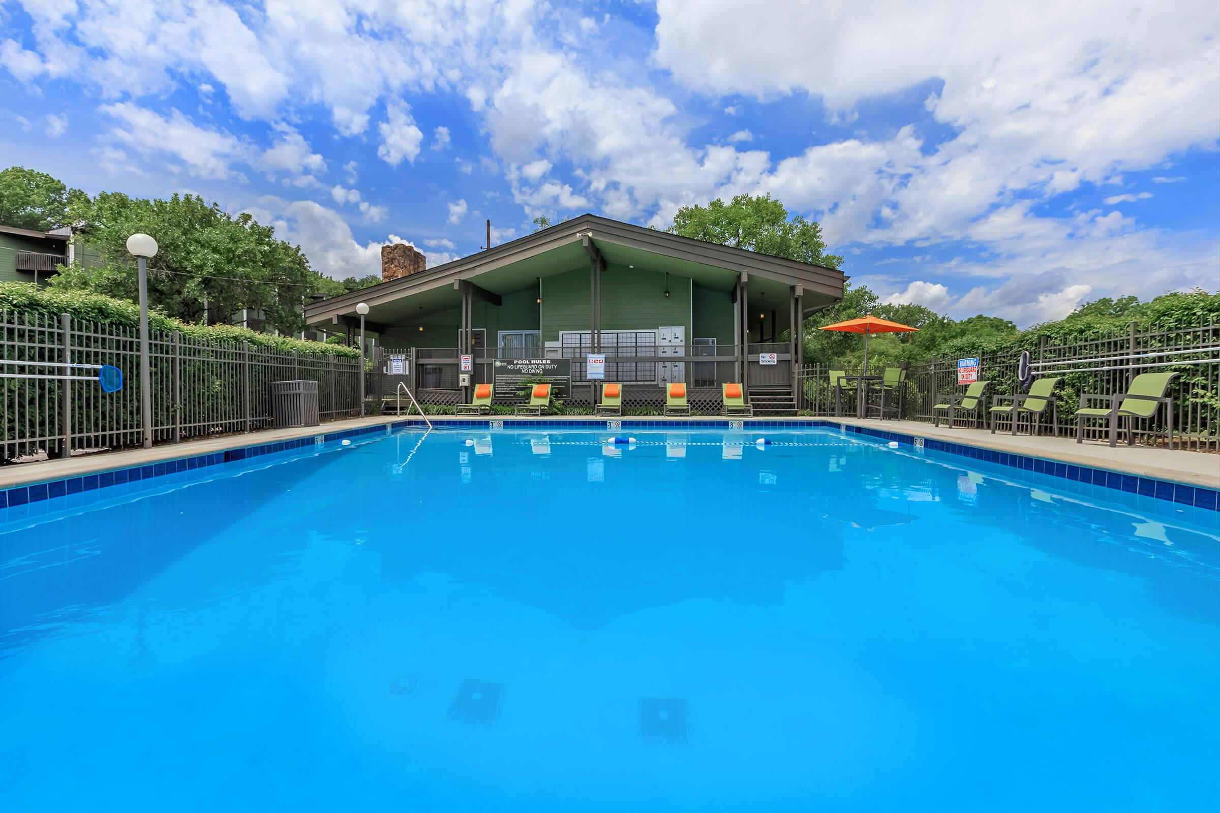 take a dive in the shimmering swimming pool at Sunrise Apartments in Nashville, Tennessee