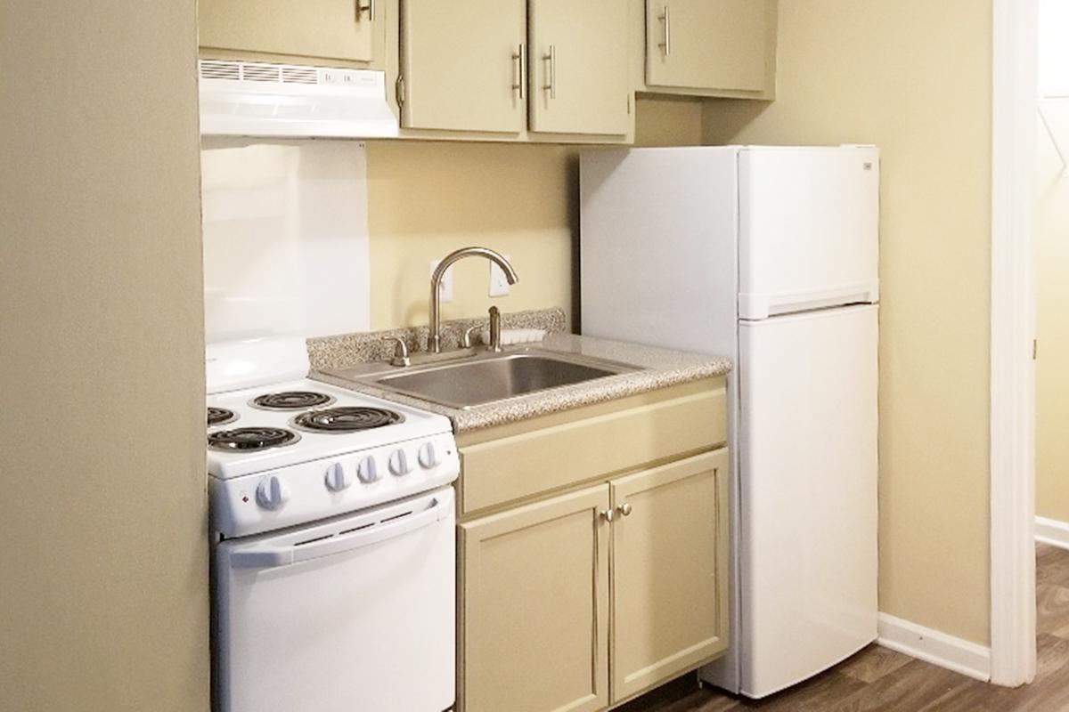 a kitchen with a white stove top oven sitting inside of a refrigerator