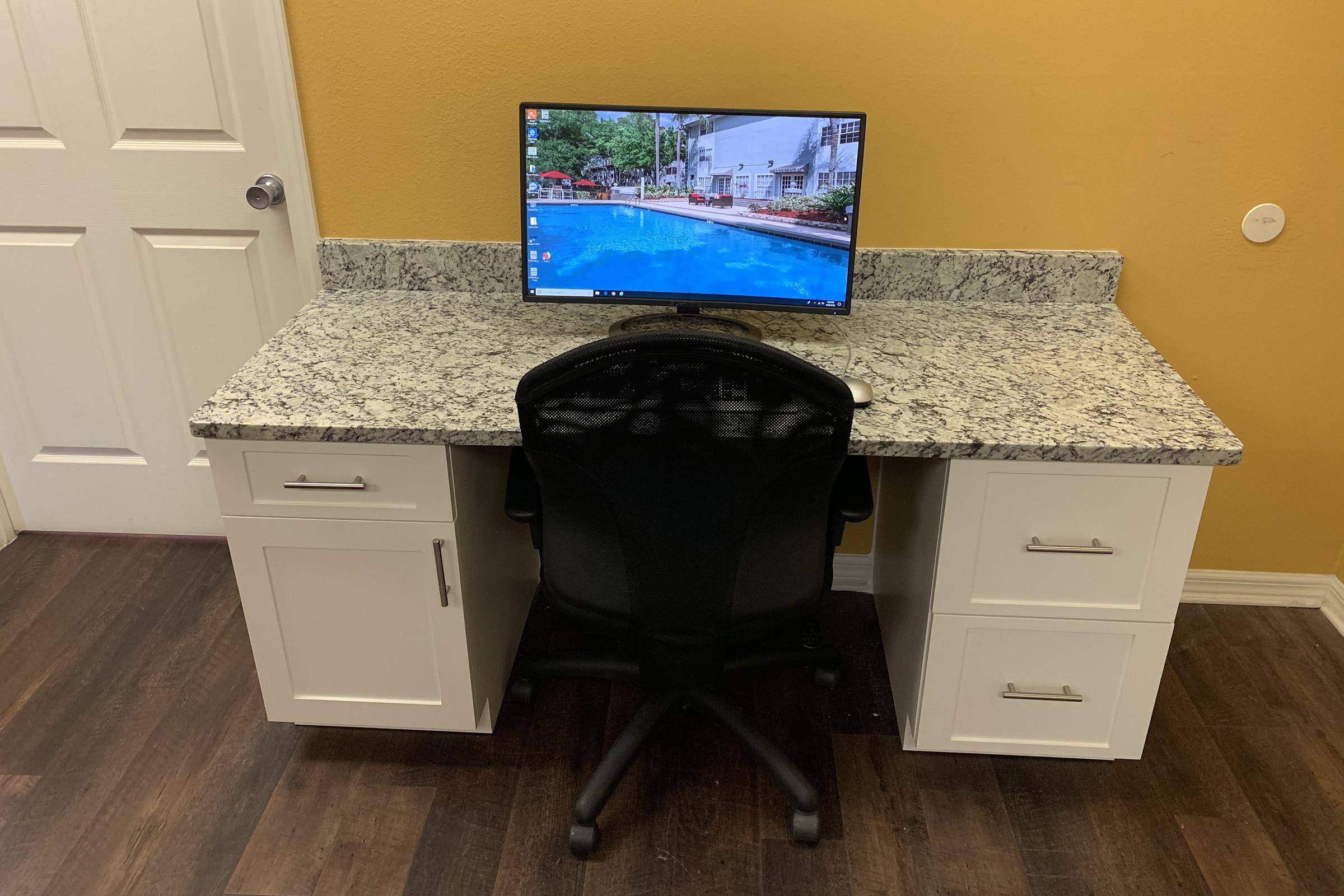 a desk with a computer