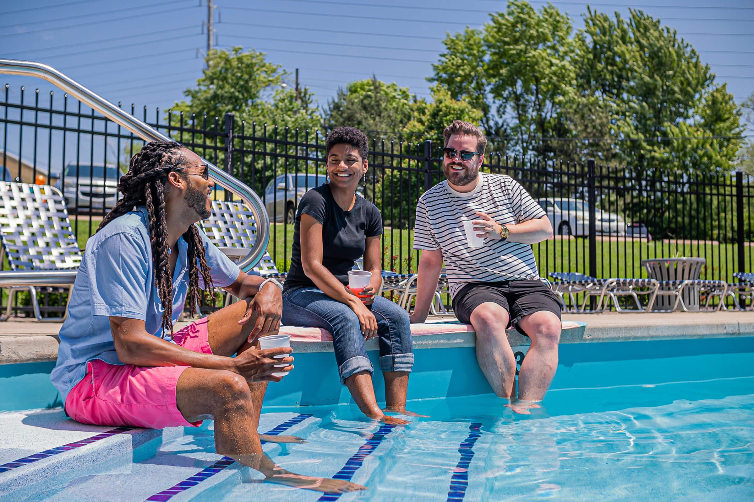 a group of people sitting in a pool of water