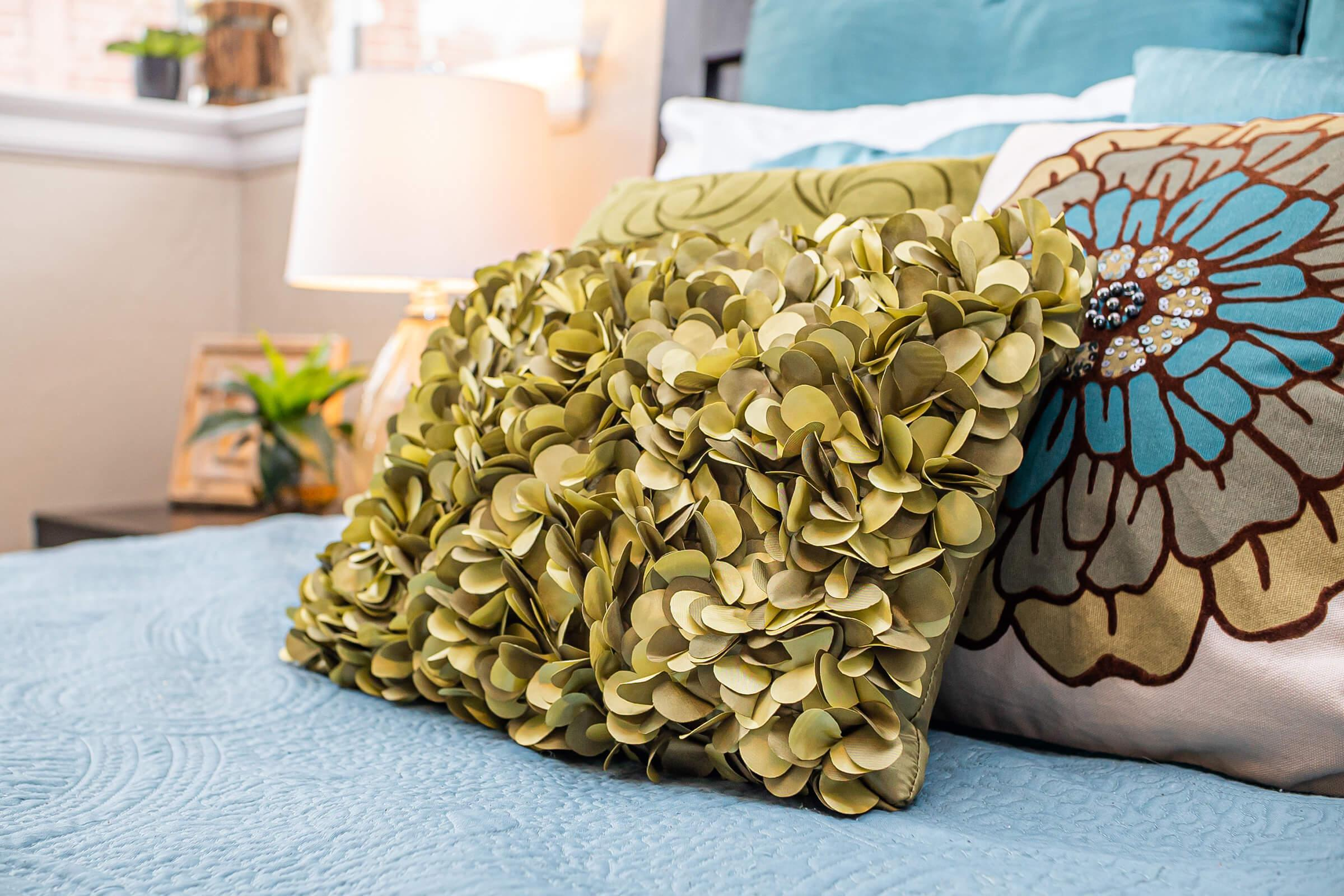 a vase of flowers sitting on a bed
