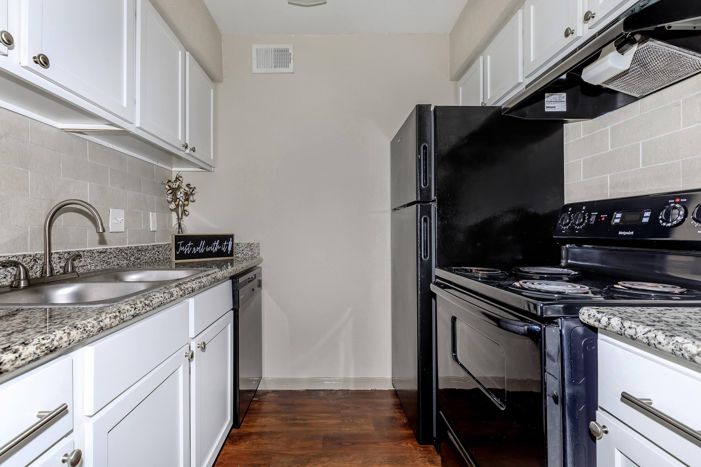 a kitchen with a stove top oven