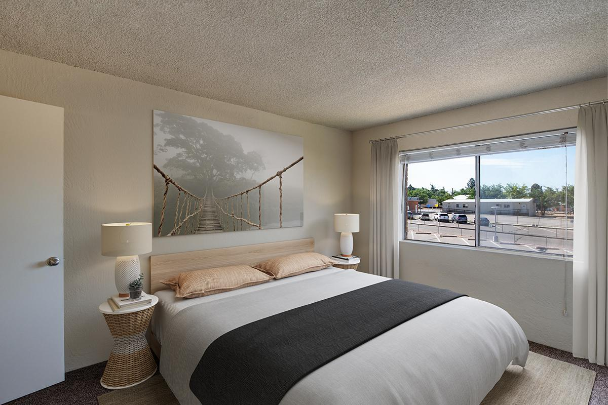 COZY BEDROOMS AT THE TOWERS APARTMENTS