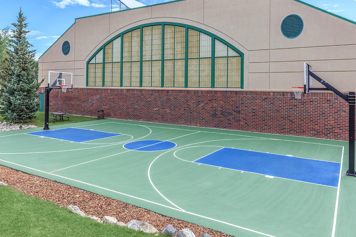 a green ball on a court