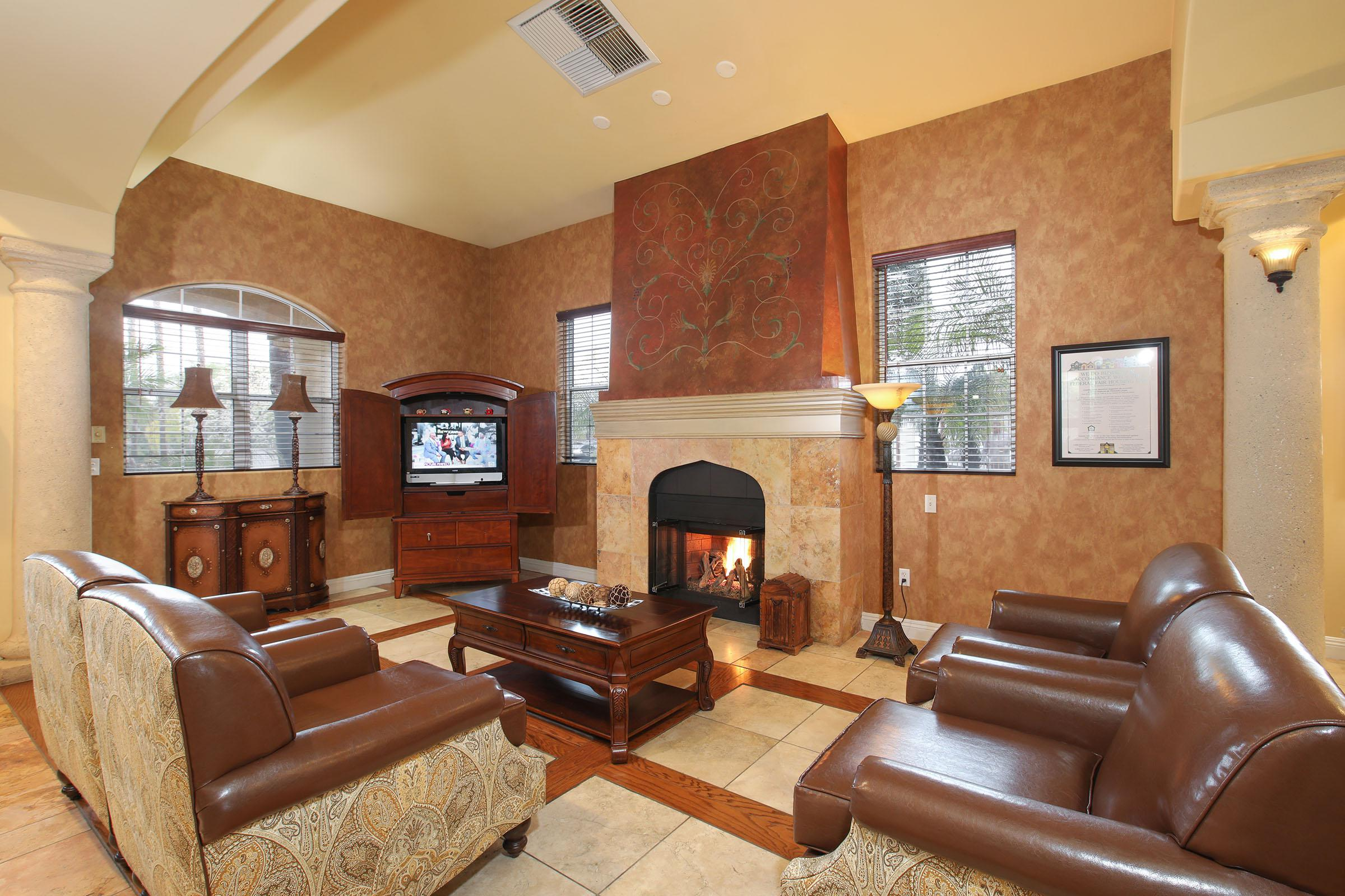 a living room filled with furniture and a fire place sitting in a chair