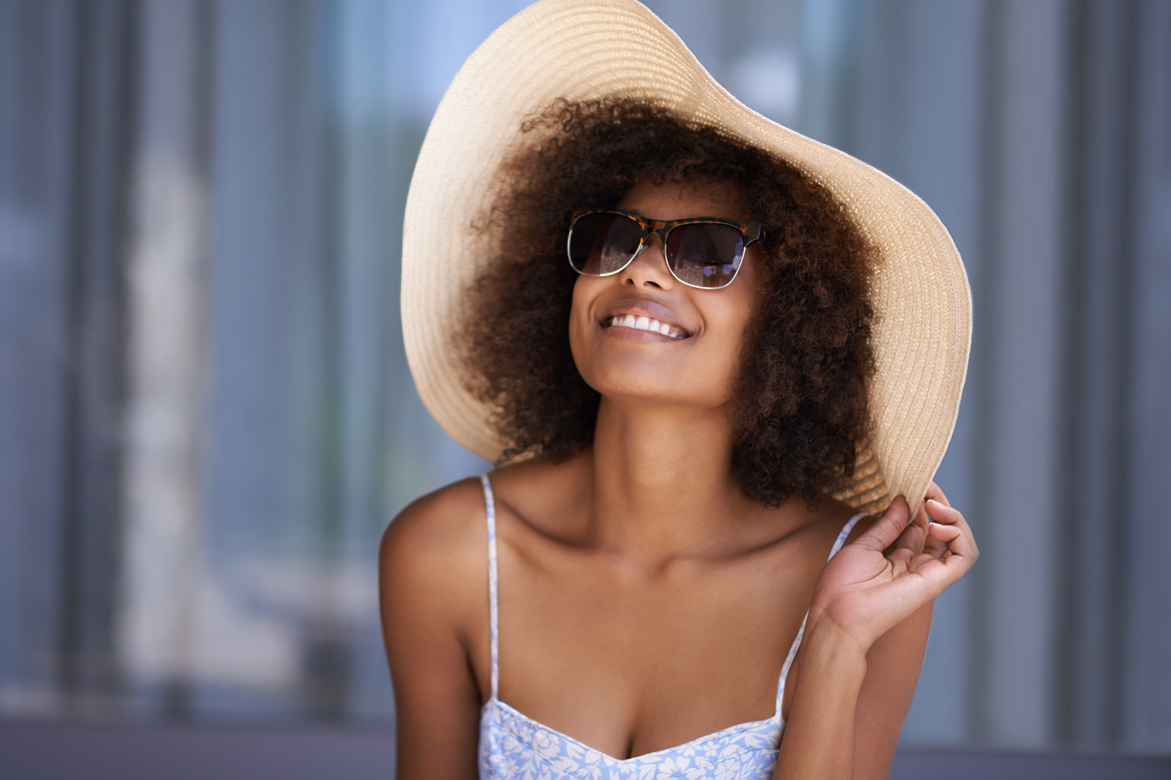 a person wearing a hat and sunglasses